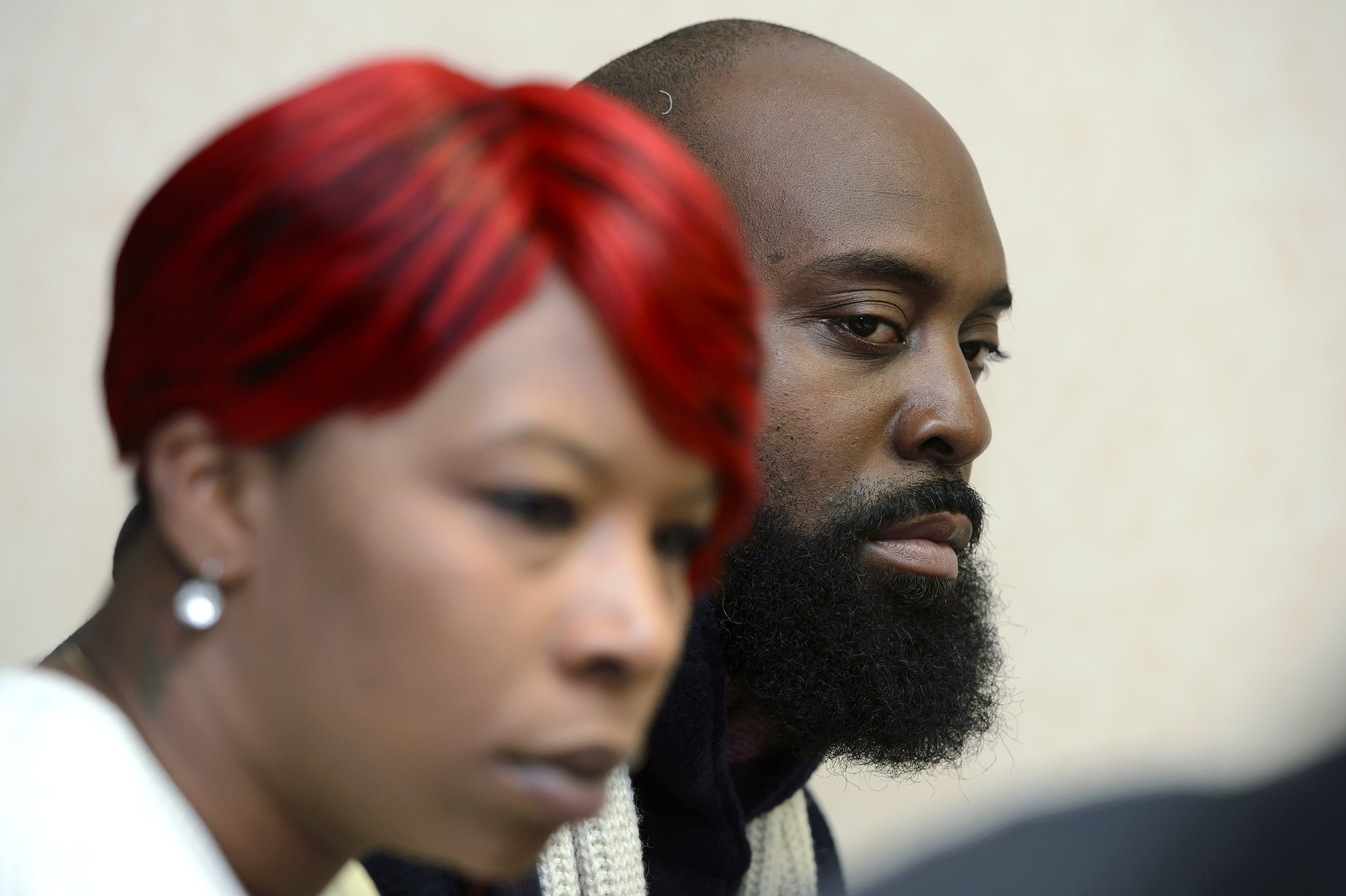 Lesley McSpadden and Michael Brown, Sr., parents of teenager Michael Brown, who was shot by a policeman in Ferguson, Missouri, speak during a press conference about the UN Committee Against Torture in Geneva, Switzerland on Nov. 12.