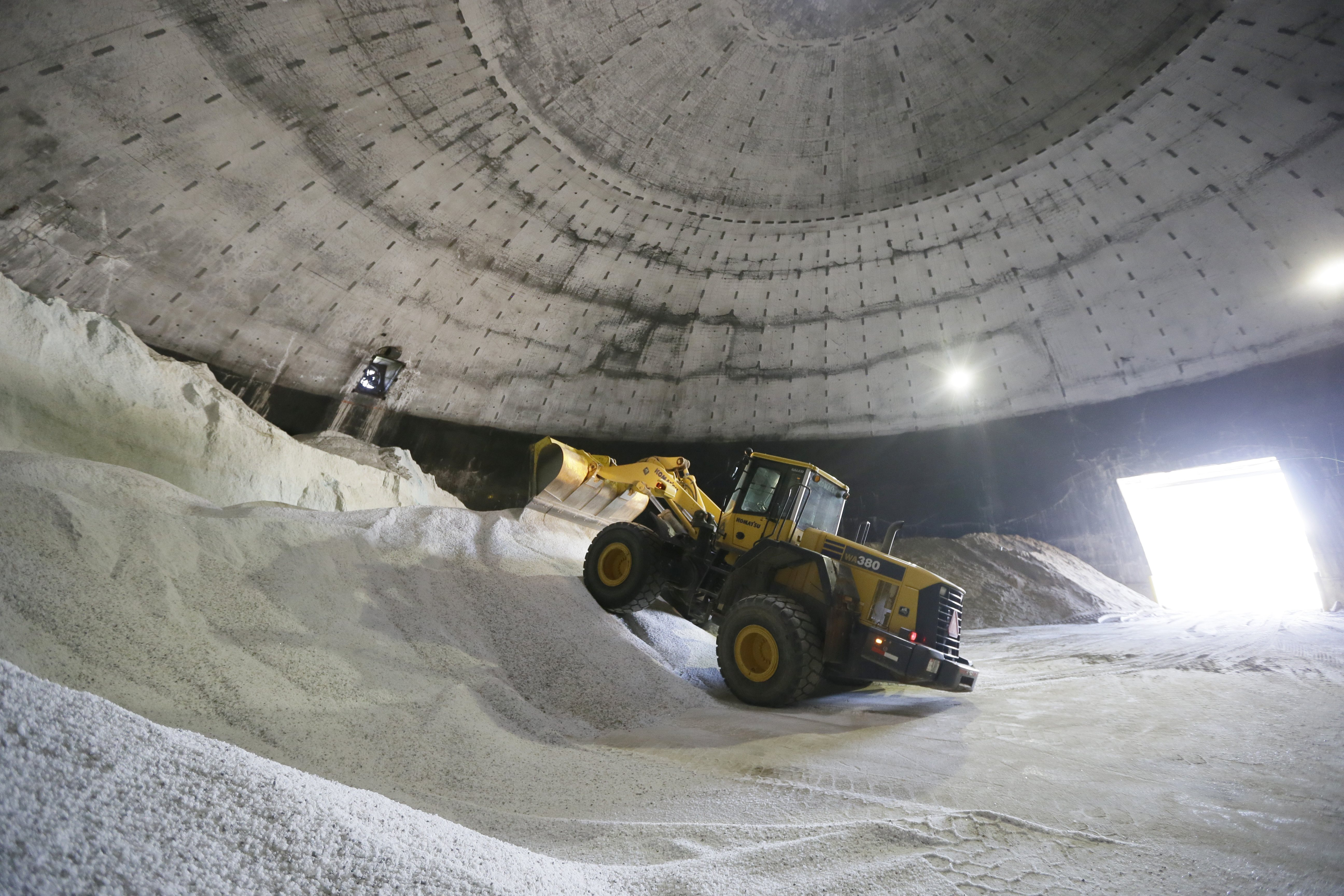 Salt is unloaded at the Scio Township, Mich. maintenance yard on Sept. 16, 2014. Some Midwest county road officials are facing price increases that are three times what they paid last year.