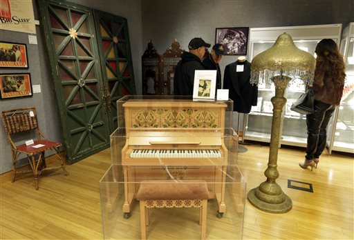 This Nov. 21, 2014 photo shows the piano on which Sam plays  As Time Goes By,  a bamboo and cane cafe chair the front doors of Rick's Cafe Americain, and a Moroccan-style painted metal floor lamp from  Casablanca,  part of the  There's No Place Like Hollywood  movie memorabilia auction, at Bonhams auction house, in New York.