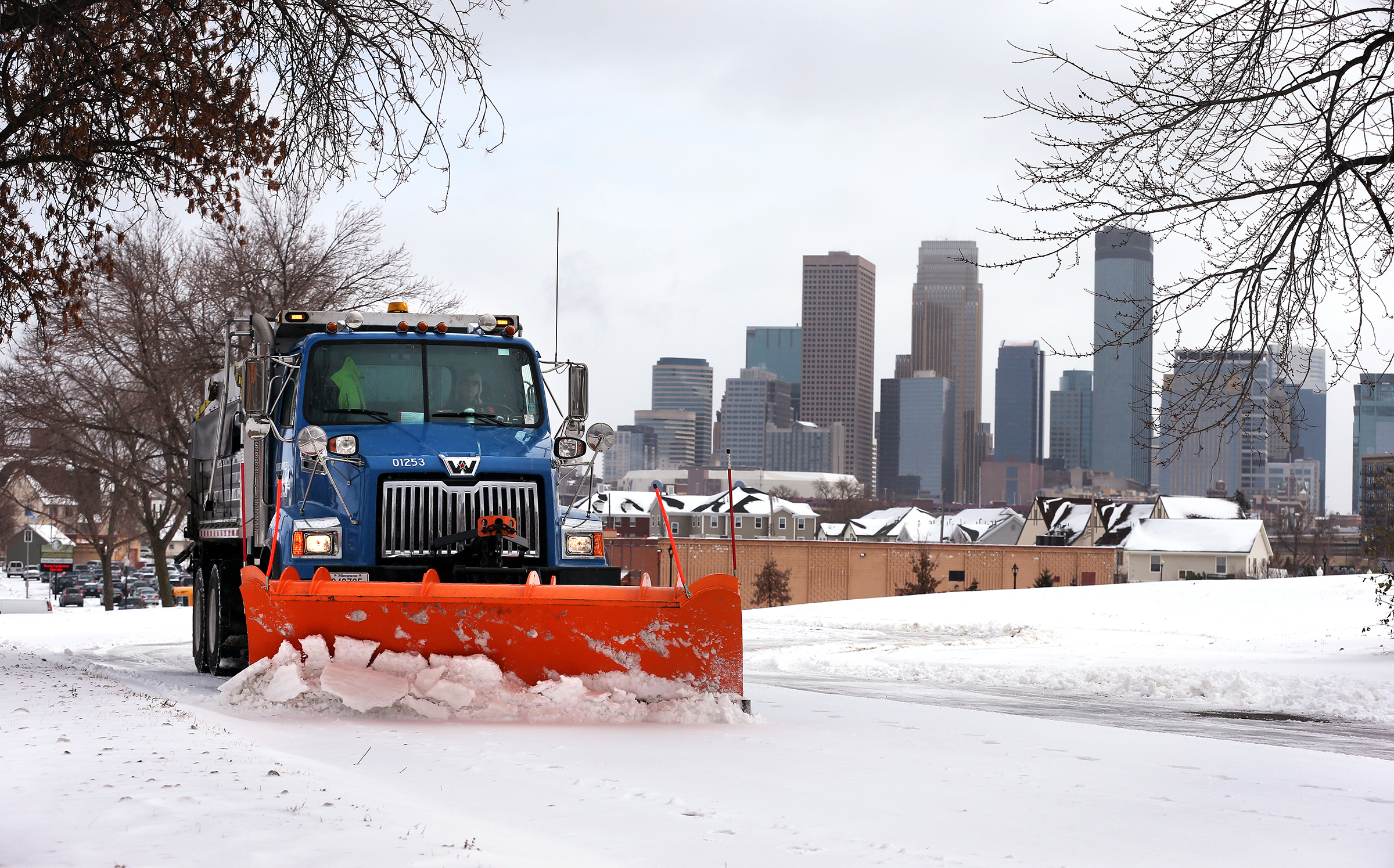 Truck driver Vicky Stich plows snow and lays down sand and salt on Olson Highway Service Road in Minneapolis on Nov. 11, 2014