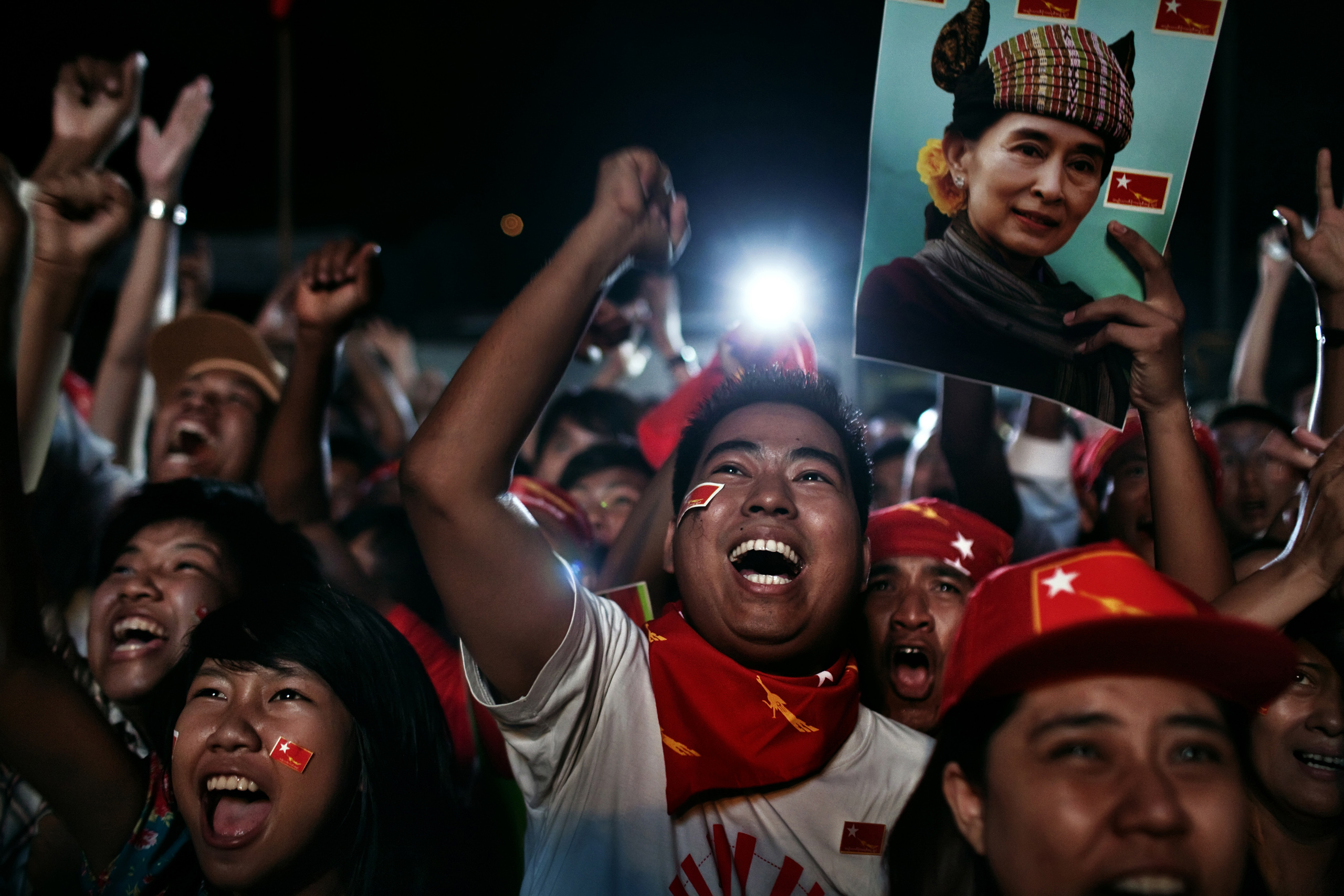 National League for Democracy (NLD) supporters celebrate at their headquarters as they watch election results Yangon, Burma, April 1, 2012.