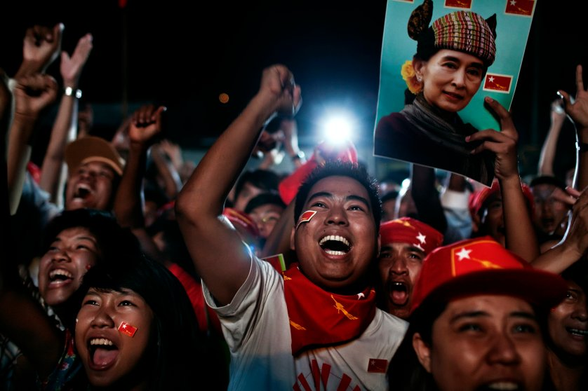 National League for Democracy (NLD) supporters celebrate at their headquarters as they watch election results Yangon, Burma, Apr. 1, 2012.