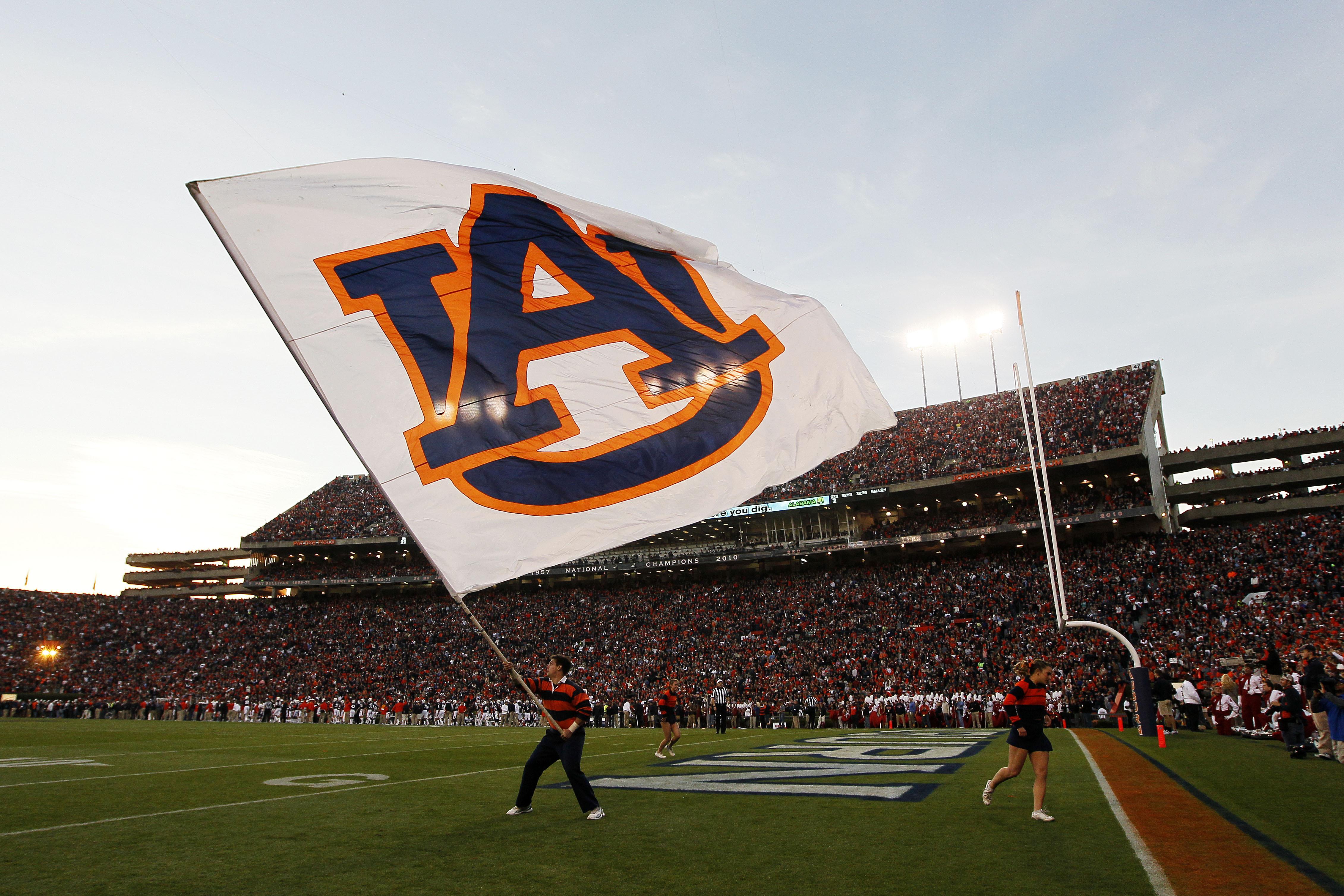 A member of Auburn Tigers cheer team waves a flag during their game against the Alabama Crimson Tide at Jordan-Hare Stadium on Nov. 30, 2013 in Auburn, Ala.