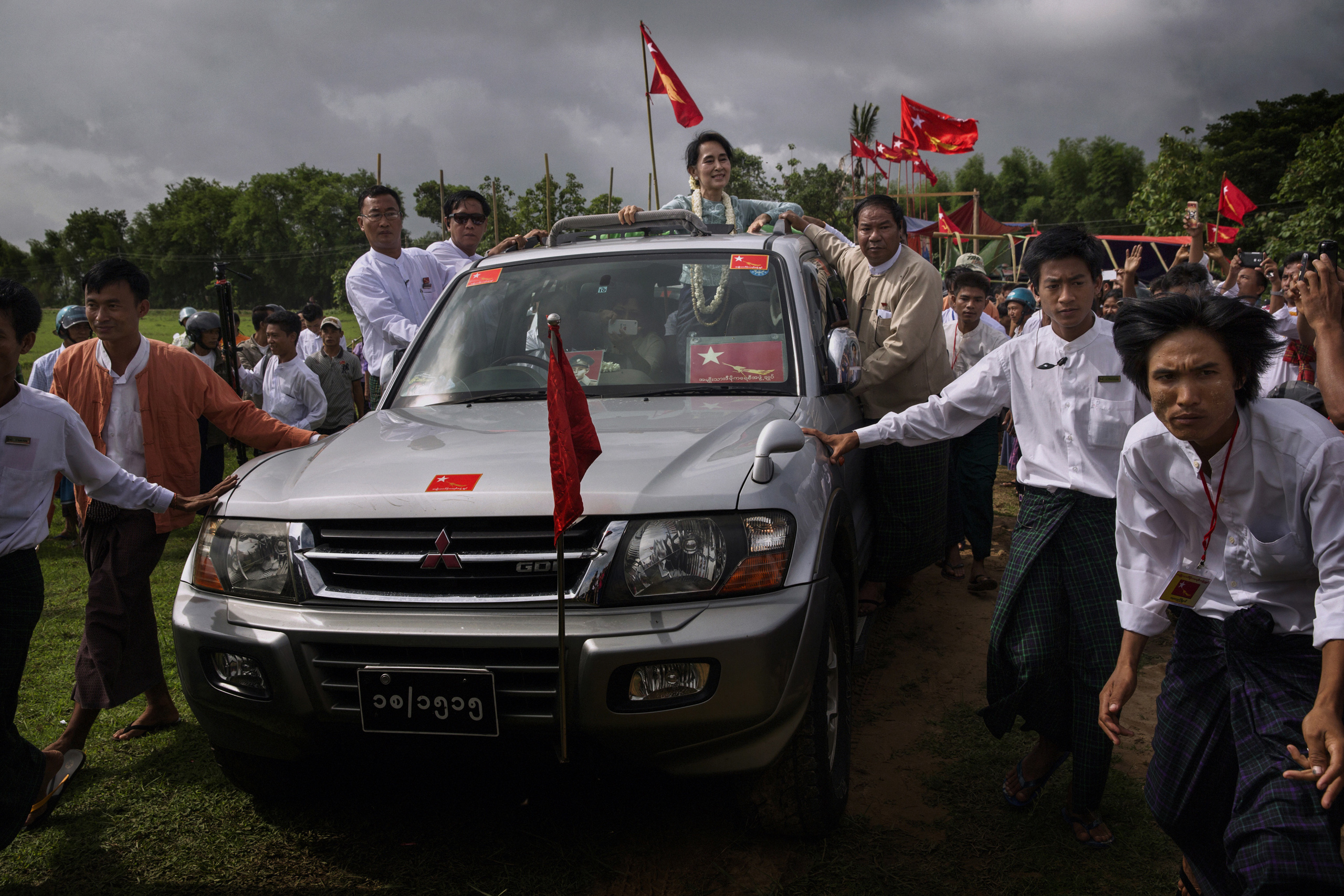 Aung San Suu Kyi leaves after speaking at a rally  in Yay Tar Shay Township, Bago Region, Burma,  June 21, 2014.