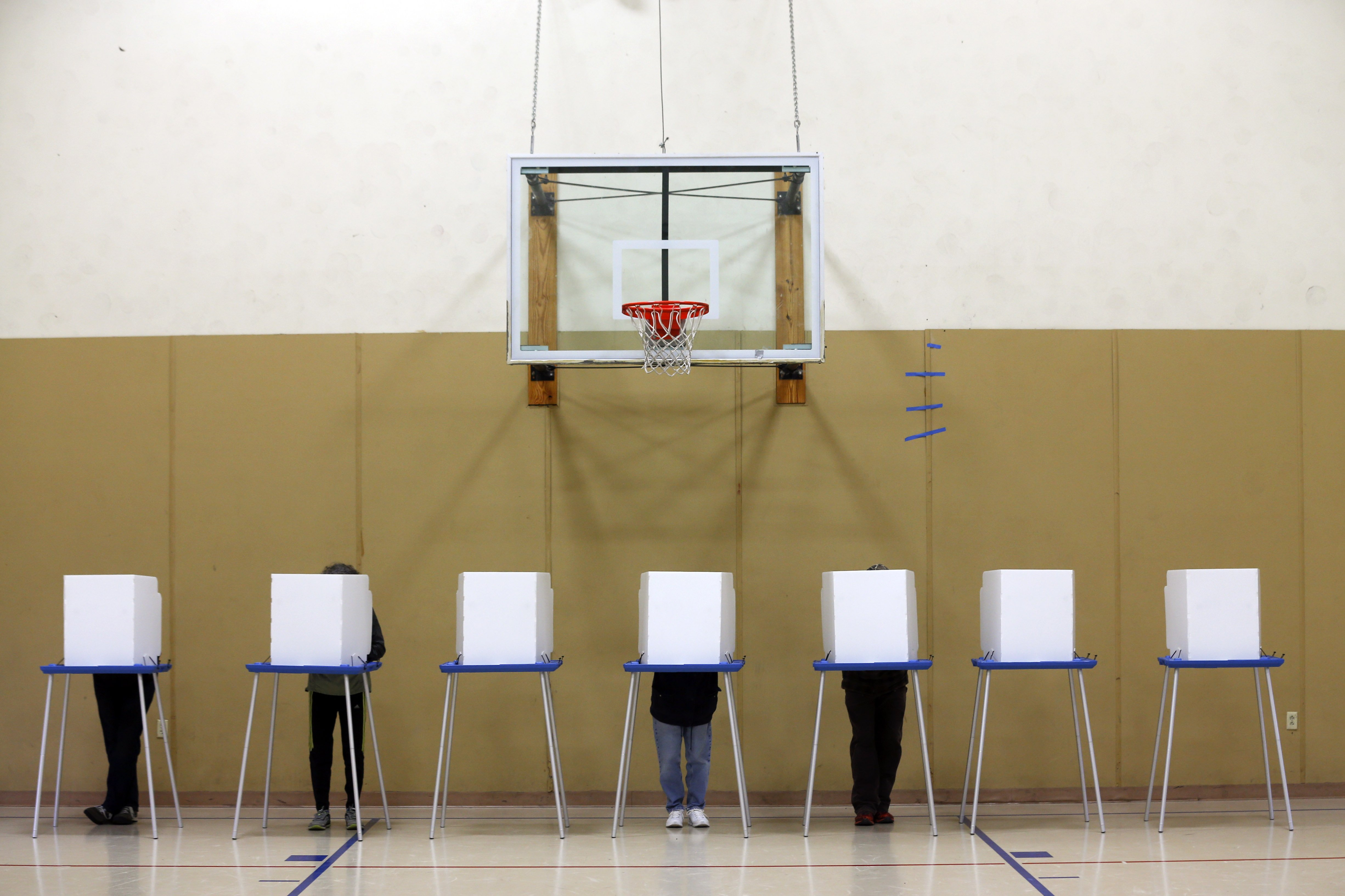 Voters fill out their ballots in a gym on election day at St. Sophia Greek Orthodox Church on Nov. 4, 2014, in Albany, N.Y.