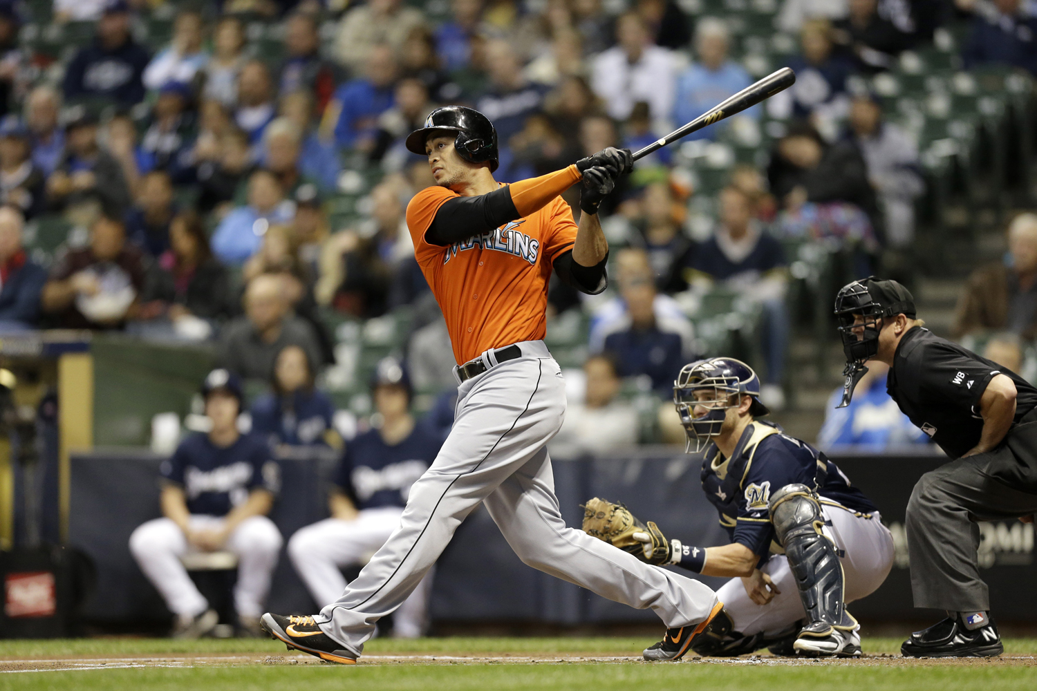 Giancarlo Stanton of the Miami Marlins makes some contact at the plate during a game against the Milwaukee Brewers at Miller Park on September 11, 2014 in Milwaukee, Wisconsin.