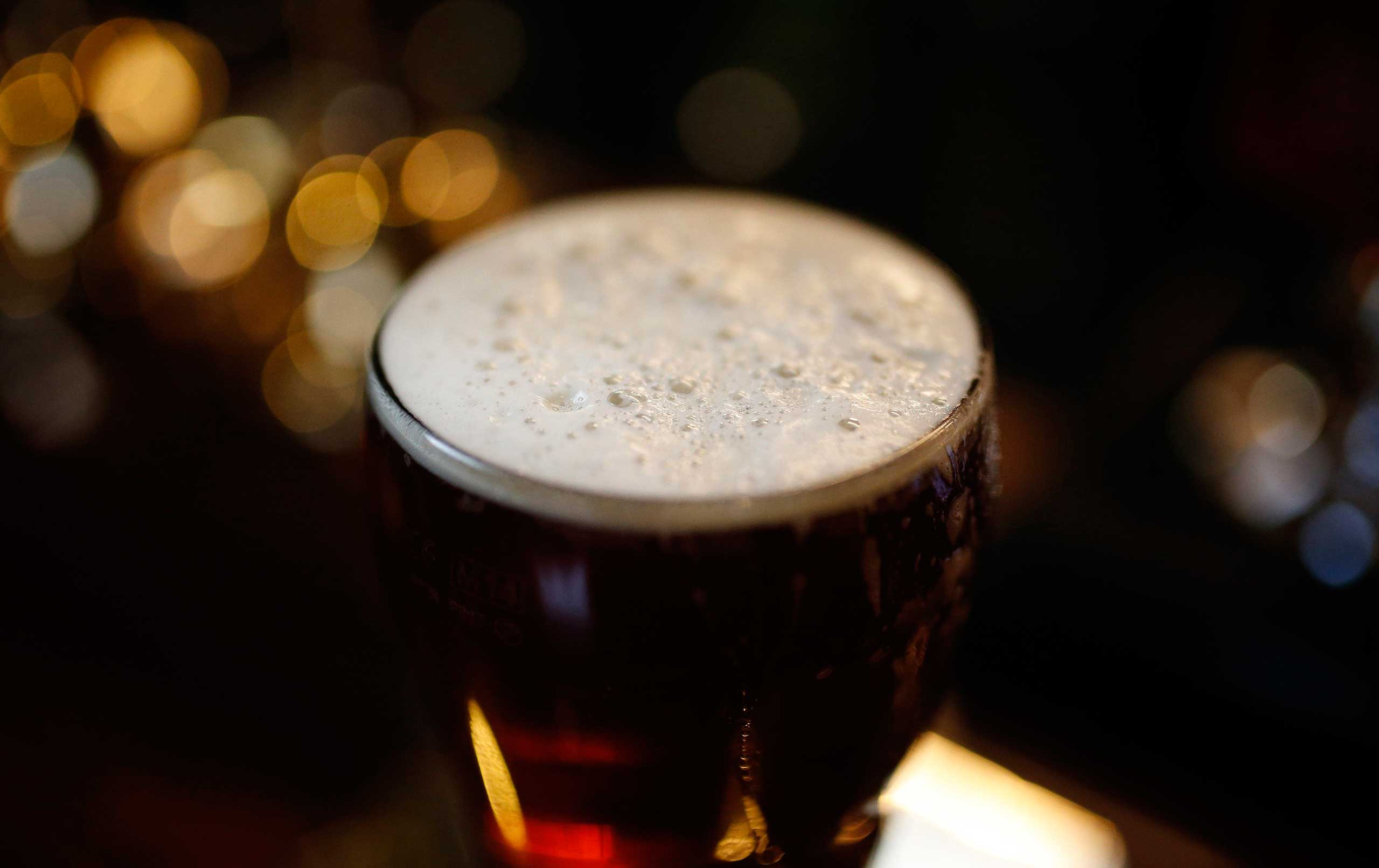 A pint of beer stands on a bar in a pub in Liverpool northern England, Nov. 19 , 2014.