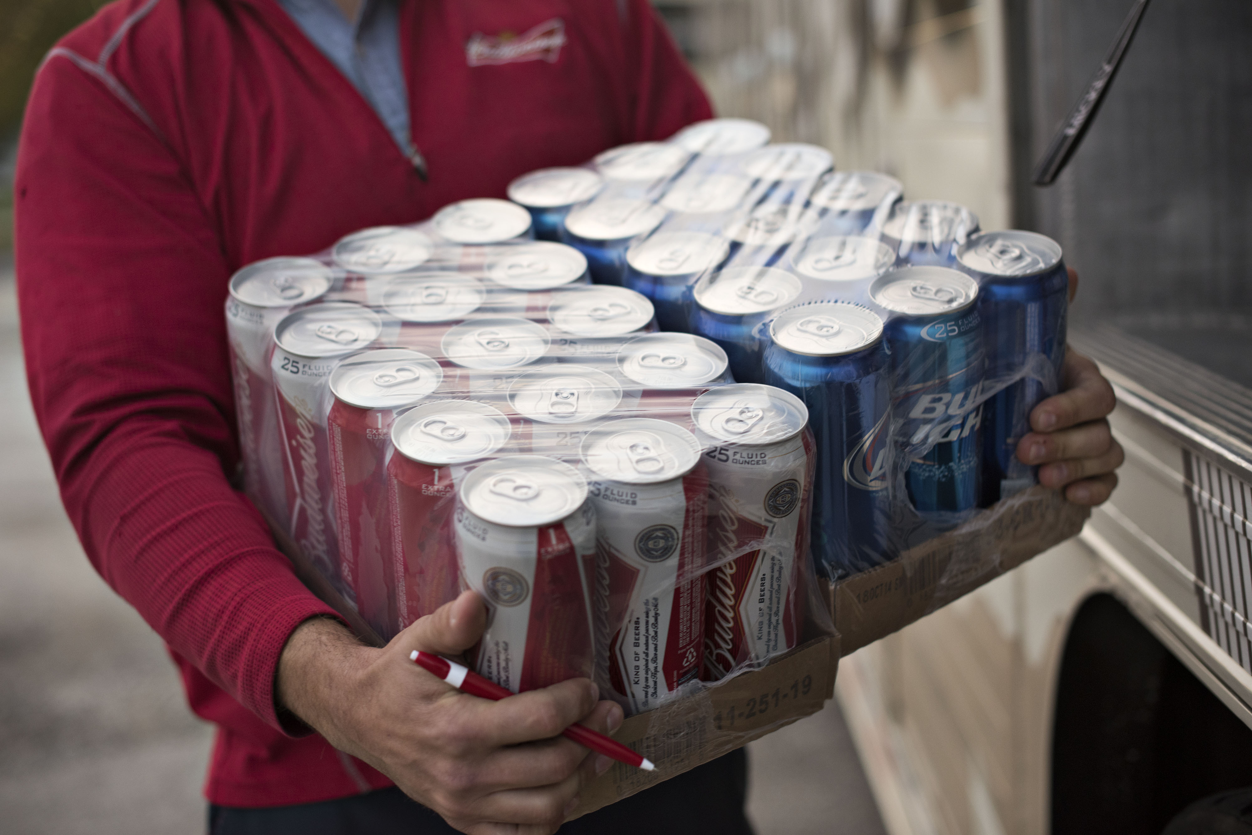 Jeff Allen, a driver for Brewers Distributing Co., delivers Anheuser-Busch beer in Pekin, Illinois, U.S., on Thursday, Oct. 30, 2014.