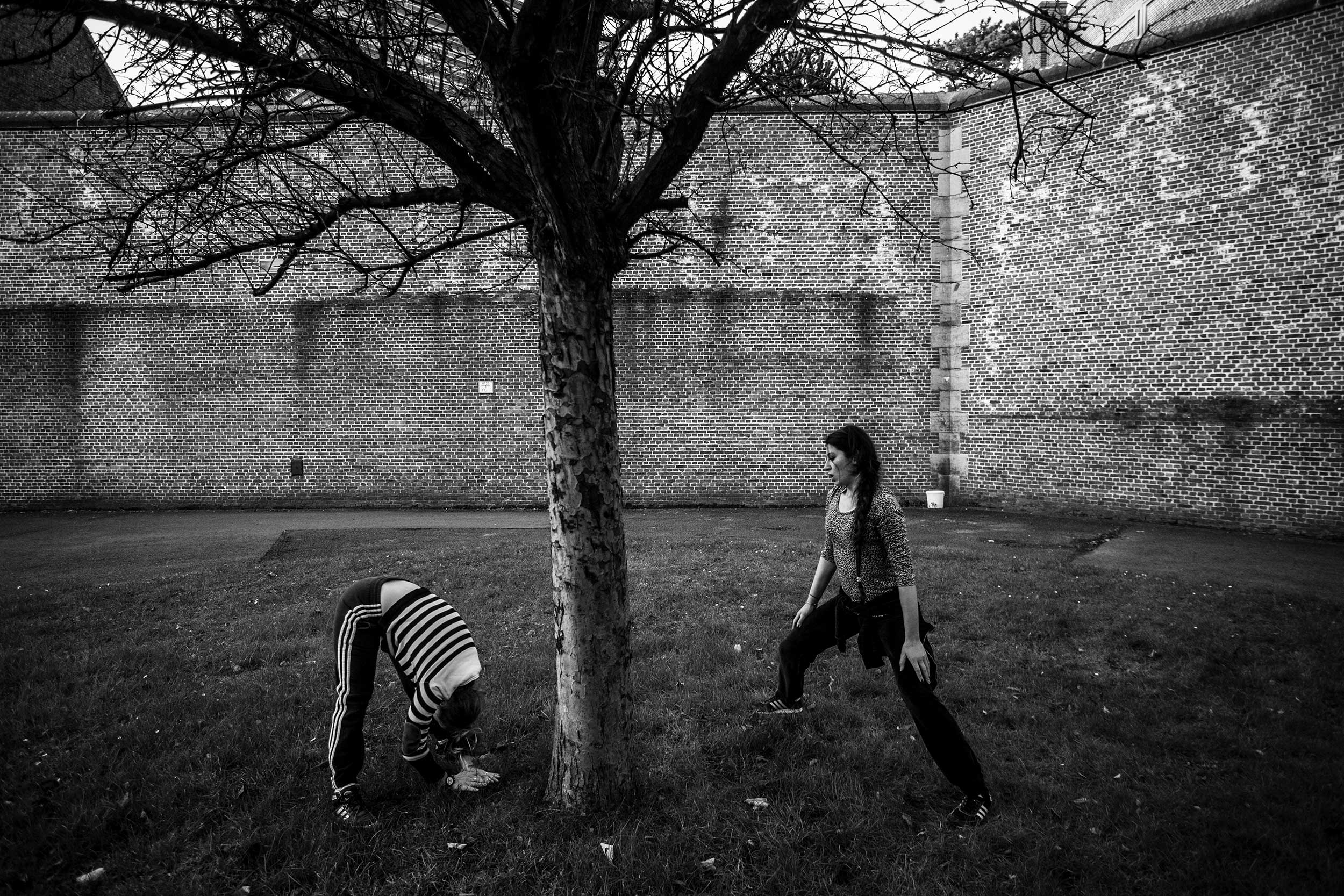 Female prisoners are exercising inside the courtyard of the prison of Ghent. They said that it was the only thing they could do to keep their mind occupied. Ghent, December 2013.