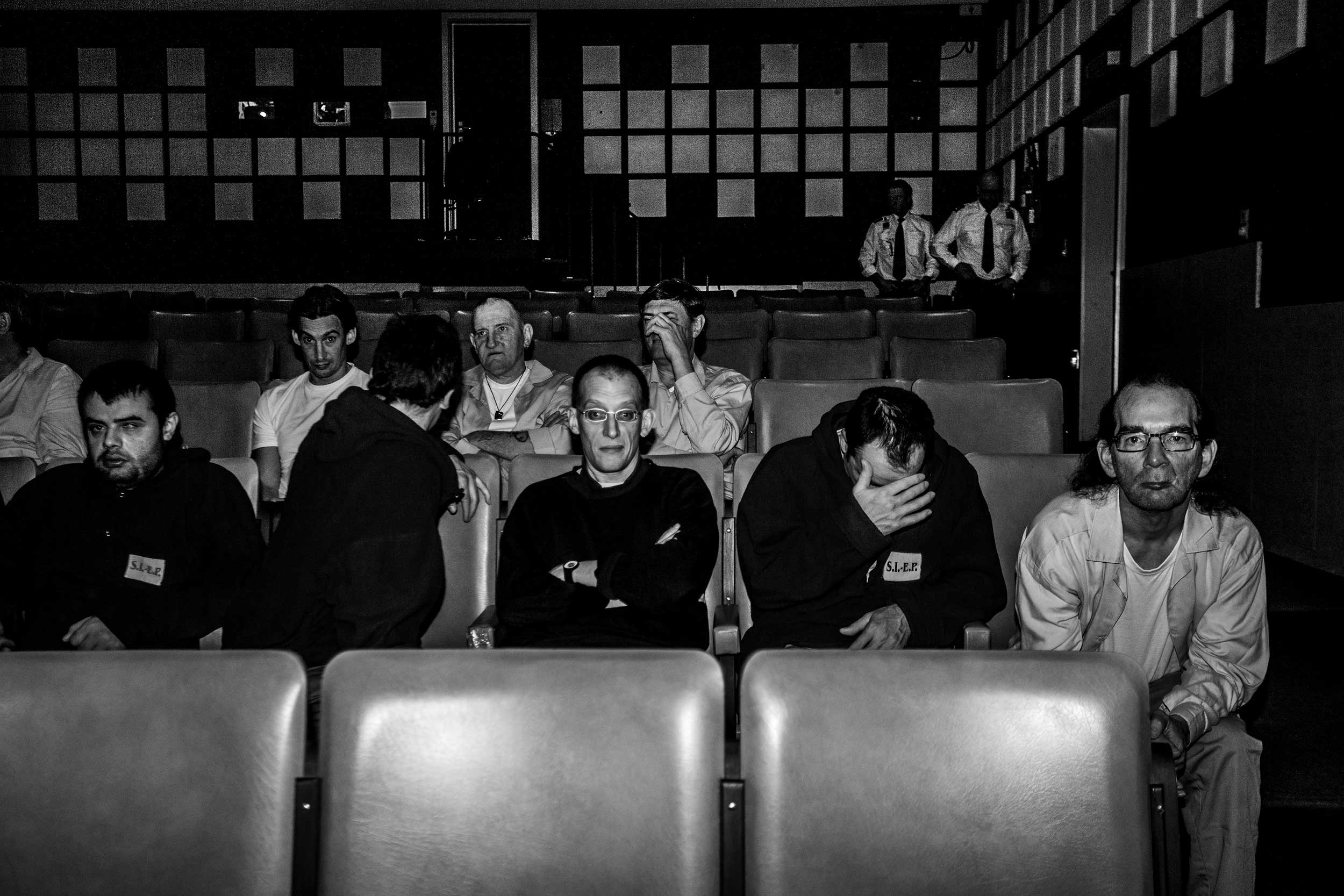 Inmates watching a film inside the movie theater of their prison in Ghent, Belgium. March 2014.
