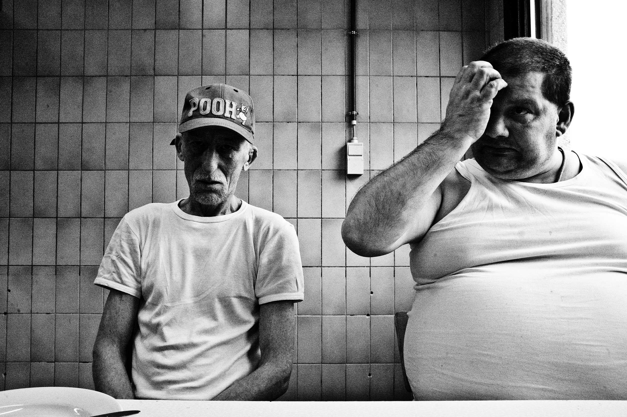 Two inmates eating in the kitchen of the prison of Paifve, Liège, Belgium. March 2011.