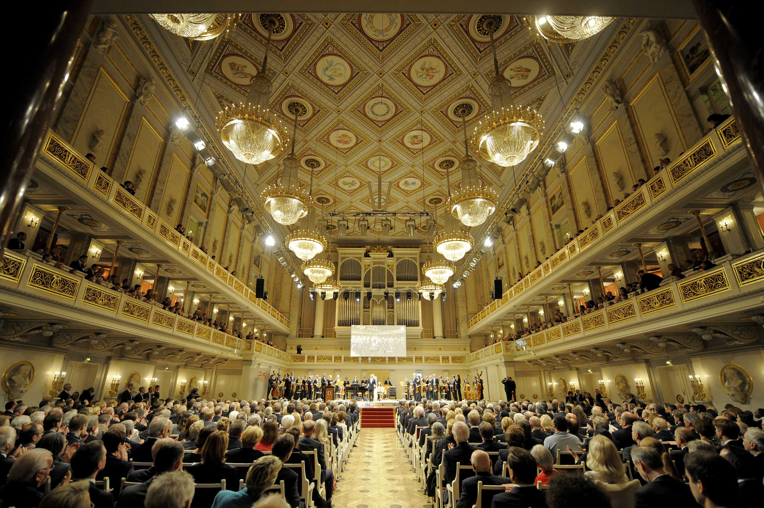 Guests attend a ceremony organised by the Berlin Senate to mark the 25th anniversary of the fall of the Berlin Wall, on November 9, 2014 at the Gendarmenmarkt Konzerthaus in Berlin.