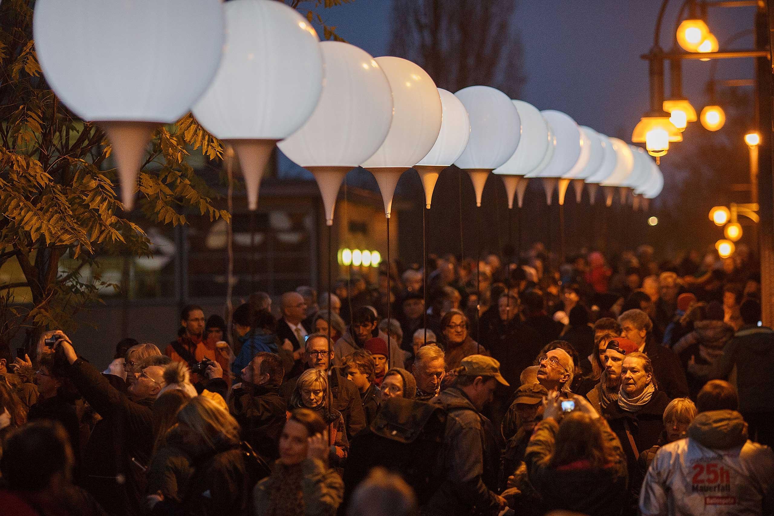 People gather on the Bösebrücke Bridge in Bornholmer Strasse on November 9, 2014 in Berlin, Germany.