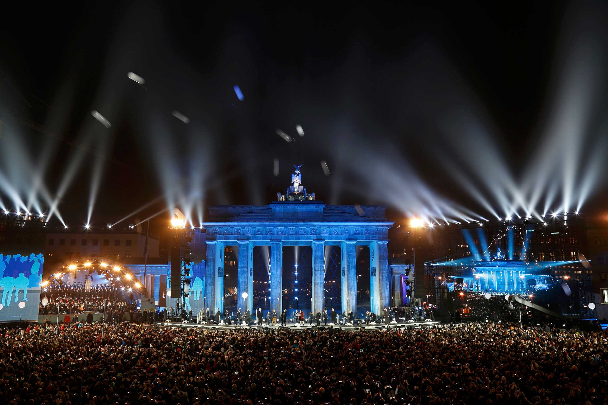 Balloons which were part of the installation 'Lichtgrenze' (Border of Light) are released in front of the Brandenburg Gate in Berlin, November 9, 2014.