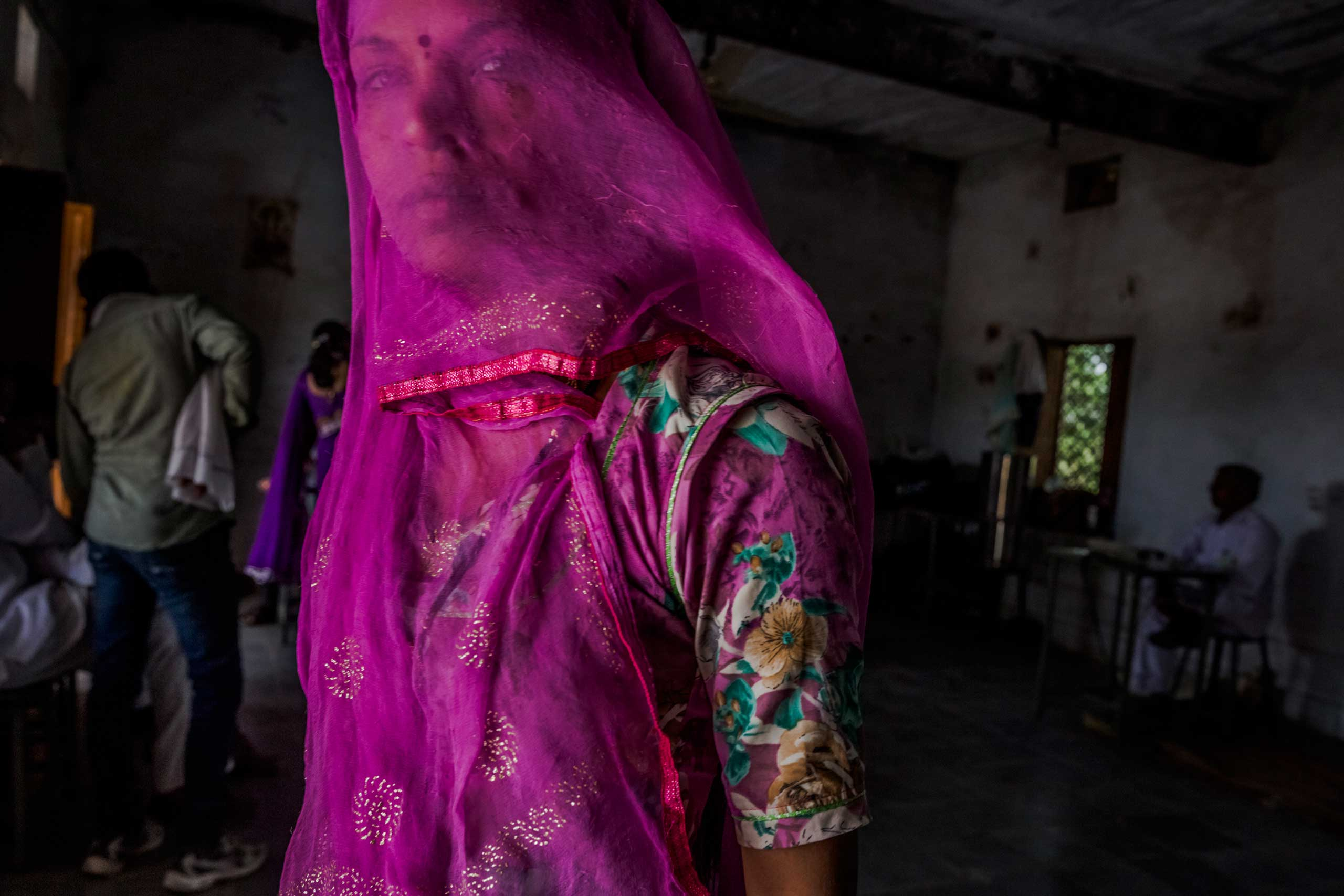 A woman waits to cast her vote at a polling station in Jodhpur, Rajasthan, India. April 17, 2014.