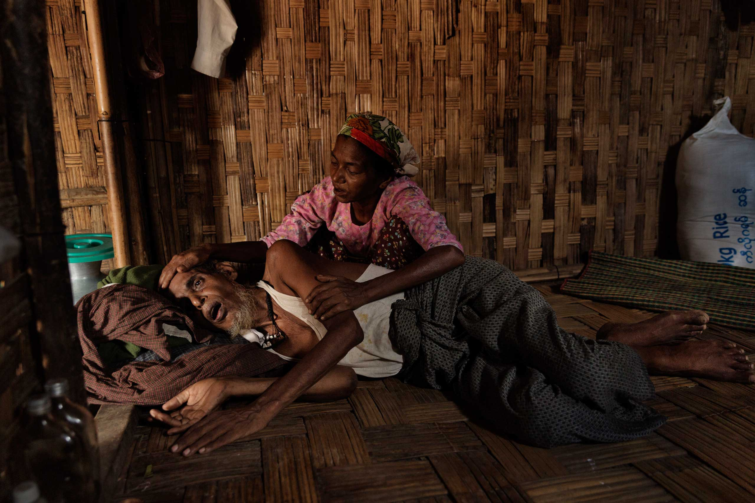 In Burma, more than 140,000 minority Rohingya Muslims have been forced to live in camps, where disease and despair have taken root.                               Here, Abdul Kadir, 65, who has a severe stomach ailment and malnutrition, is cared for by his wife in one of the camps, June 9, 2014.