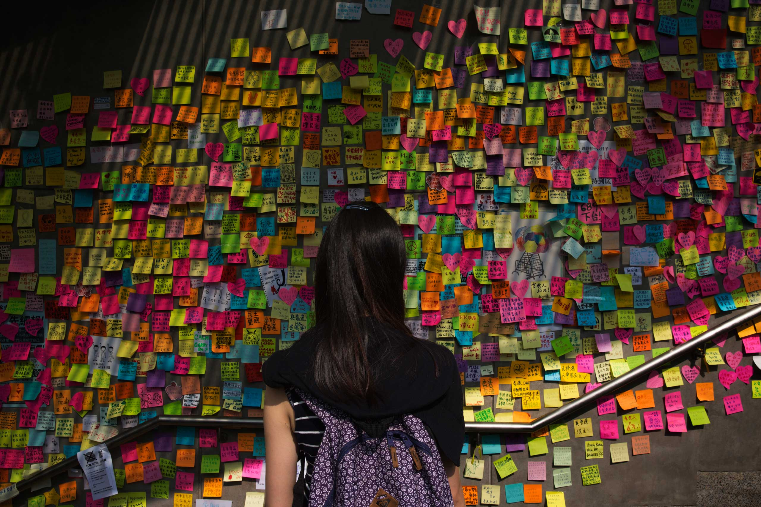 On a wall just outside Hong Kong's main government office, protesters leave words of support for one another and demands for political action, Oct. 5, 2014.                                                              Correction: The original version of this caption incorrectly identified the subject in the photograph.