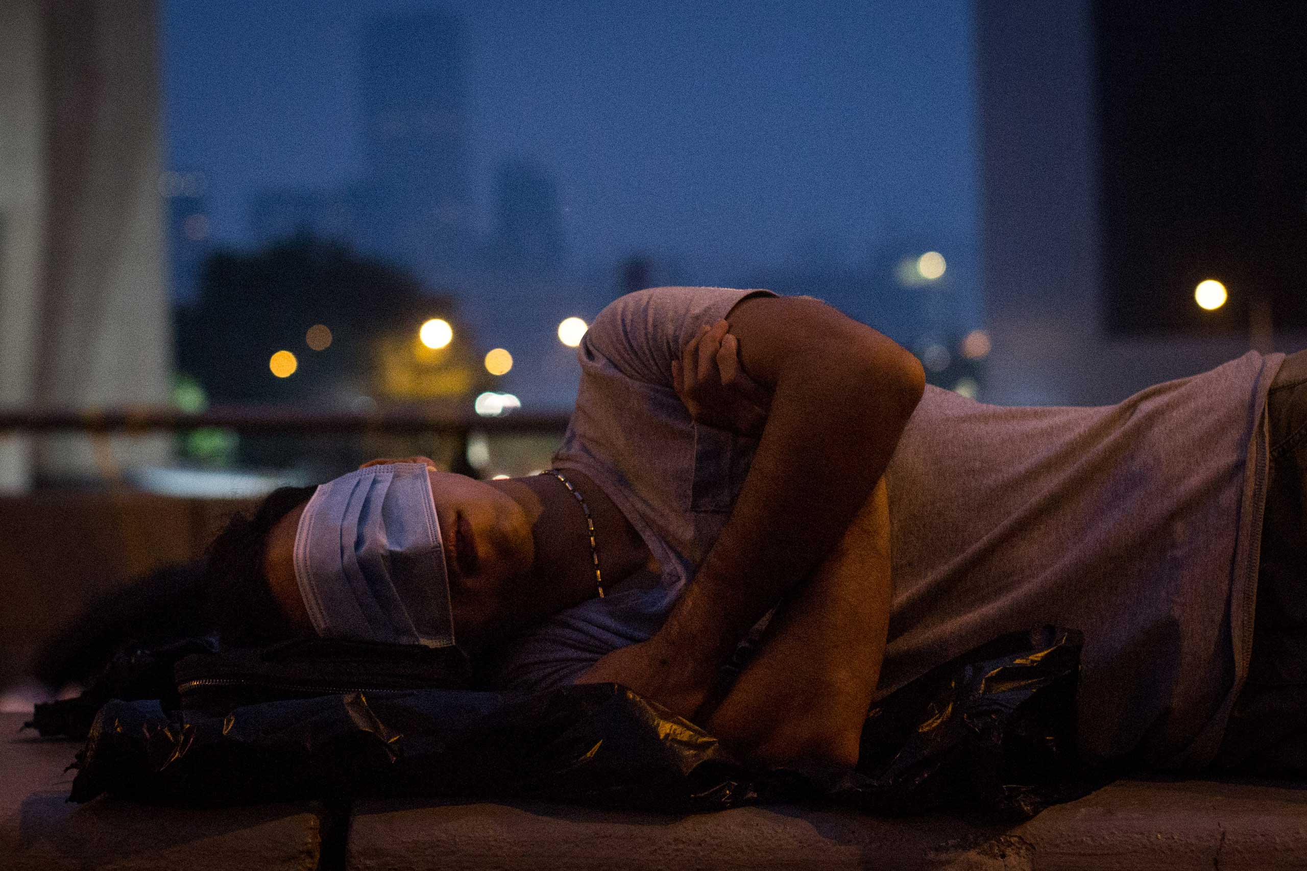 A pro-democracy protester sleeps on a concrete road divider on a street outside the Hong Kong Government Complex  in Hong Kong, Oct. 5, 2014.