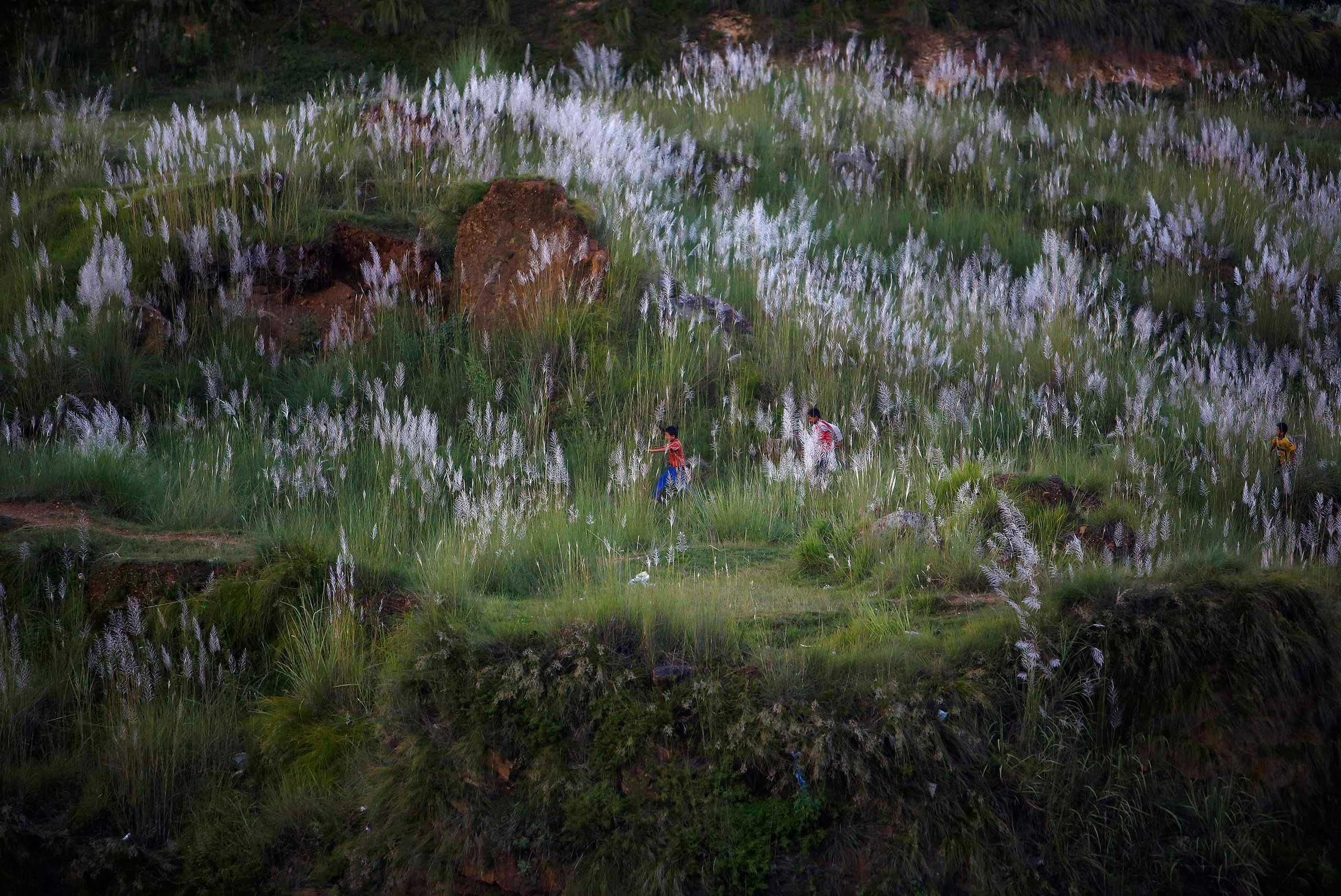 Children play on the hills in Kathmandu, Sept. 3, 2014.