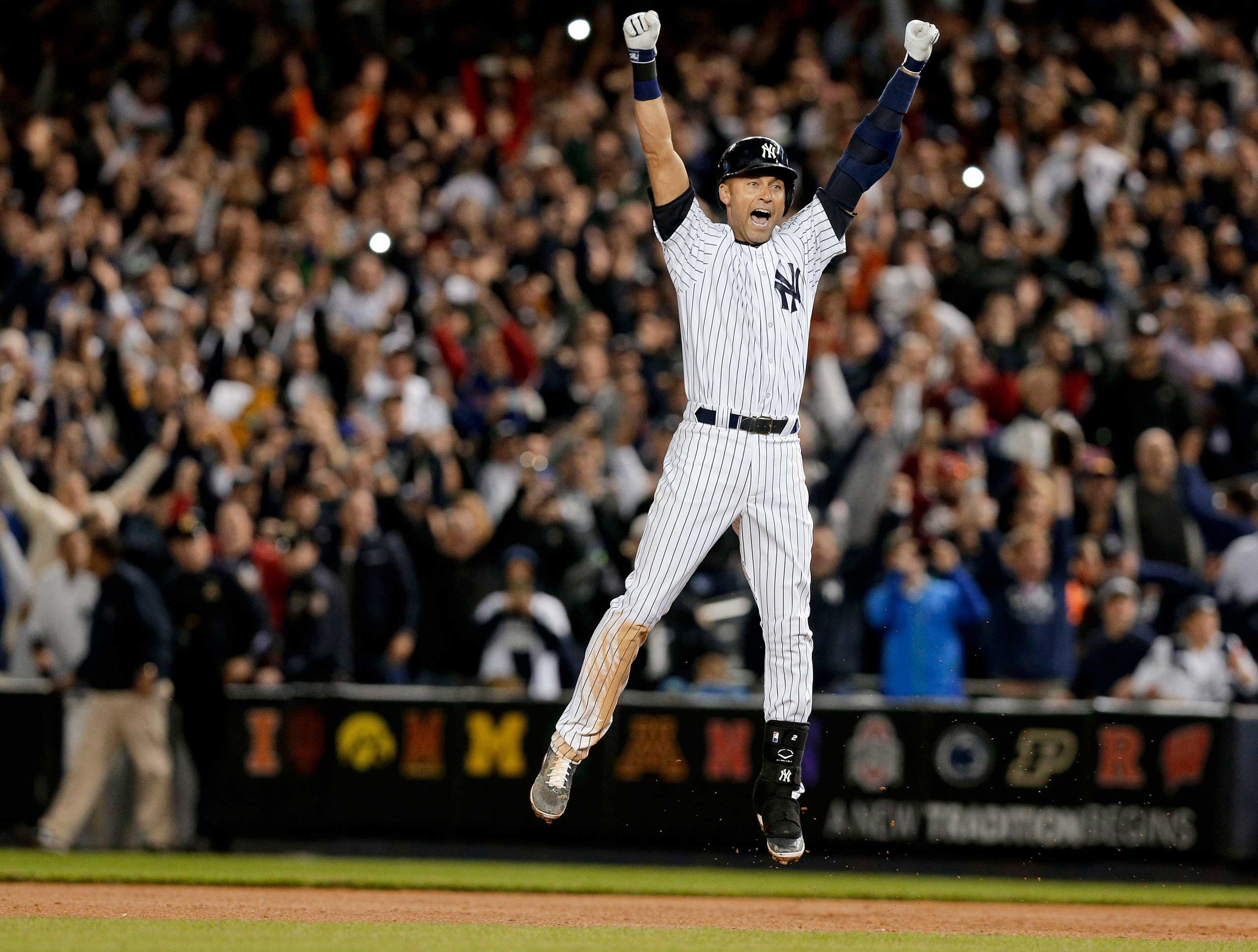 New York Yankees' Derek Jeter jumps after hitting the game-winning single against the Baltimore Orioles in the ninth inning of a baseball game, New York, Sept. 25, 2014.
