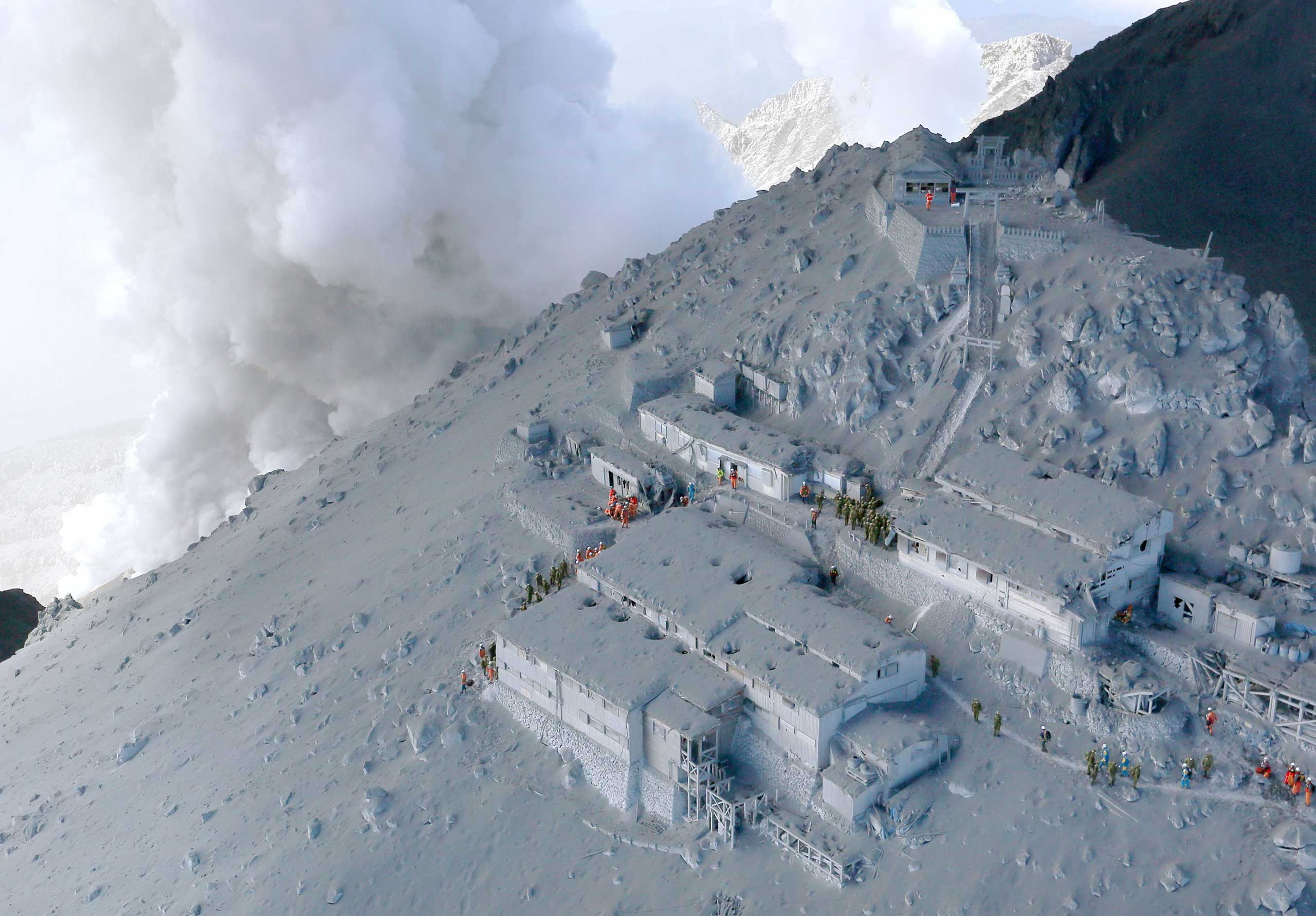 Mountain lodges near the top of Mt. Ontake in Tokyo, Japan are covered in volcano ash, Sept. 28, 2014.