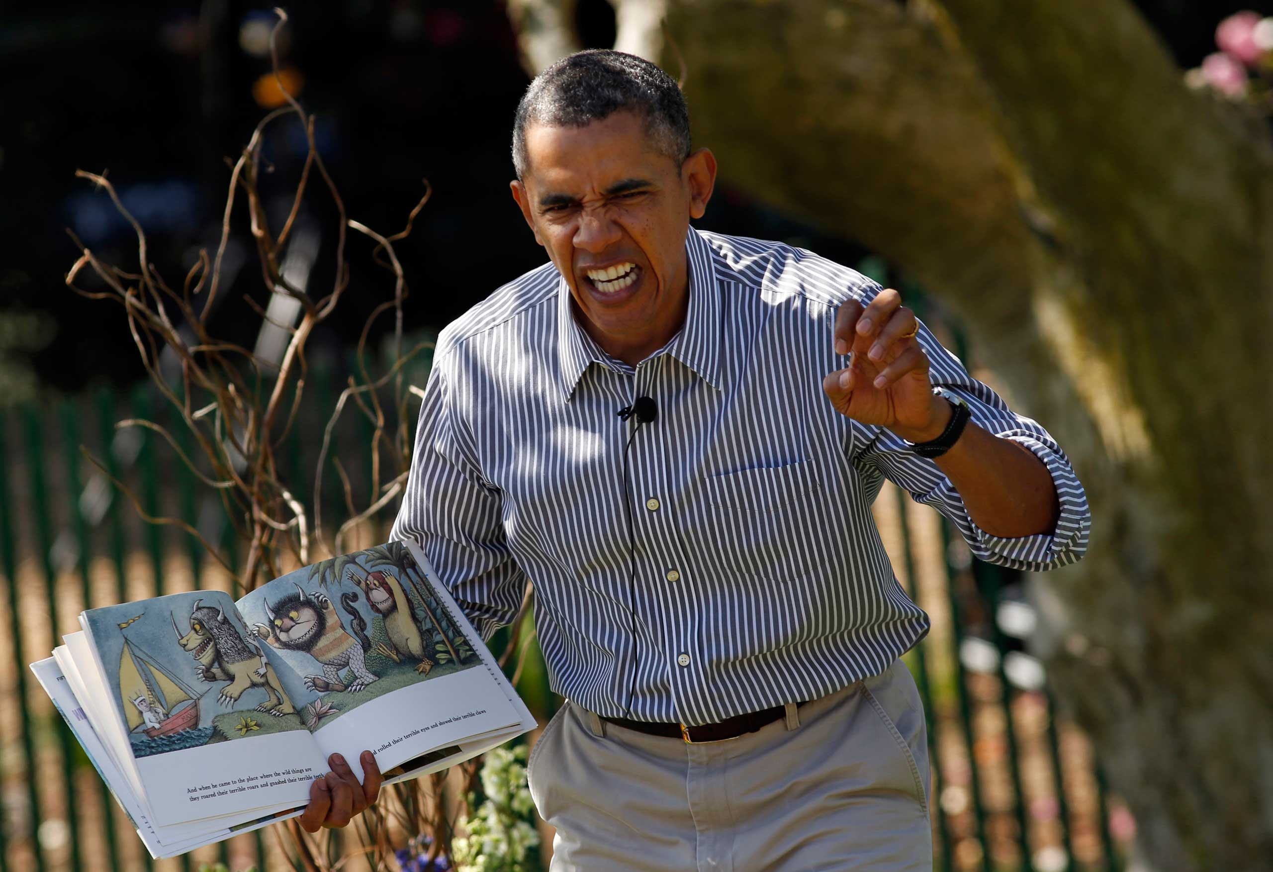 U.S. President Barack Obama acts out the line  gnashed their terrible teeth  from the children's book  Where the Wild Things Are  during the 136th annual Easter Egg Roll on the South Lawn of the White House in Washington, D.C., April 21, 2014.