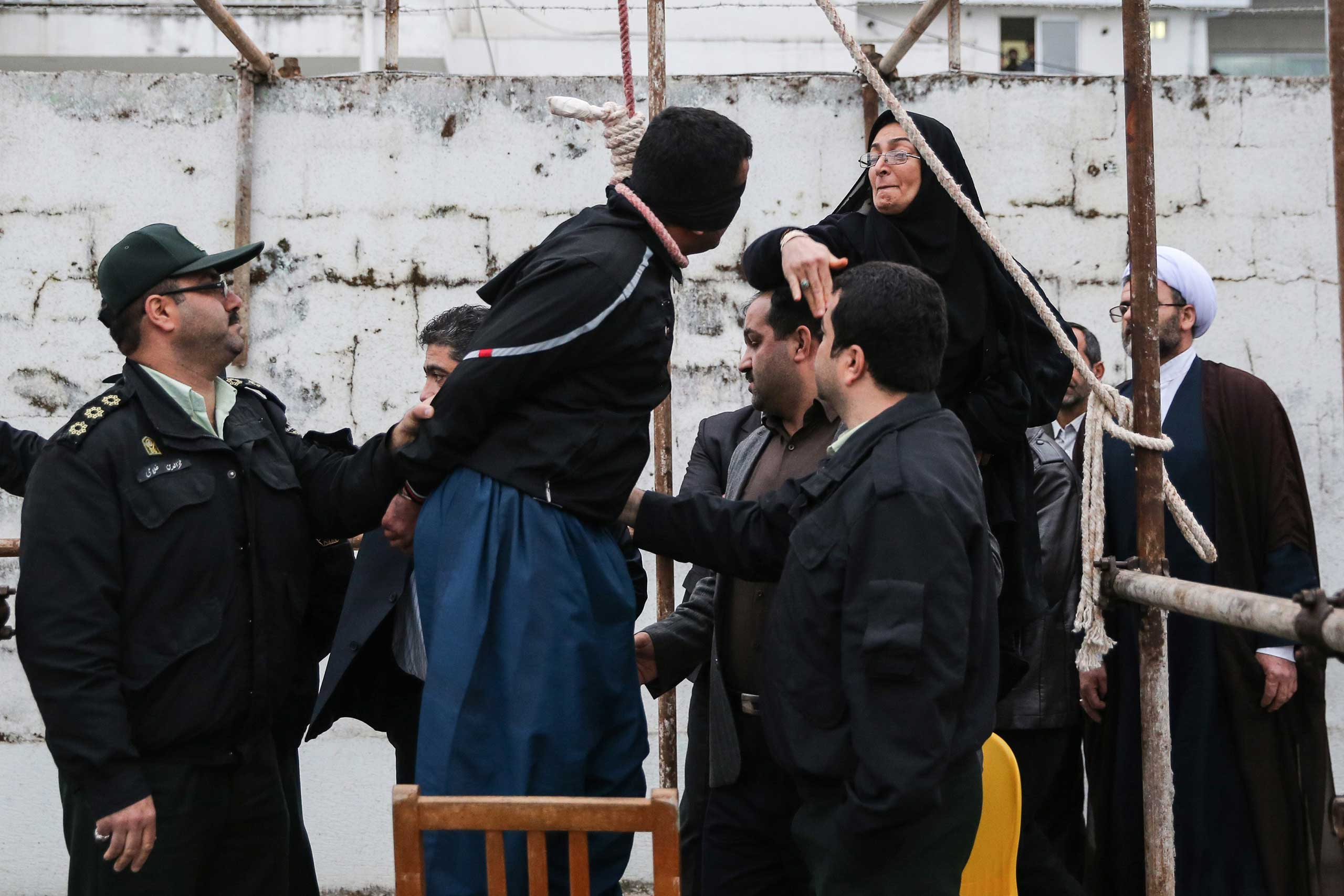 The mother of Abdolah Hosseinzadeh, who was murdered in 2007, slaps Balal who killed her son during the execution ceremony in the northern city of Nowshahr just before she removed the noose around his neck with the help of her husband, sparing the life of her son's convicted murderer, April 15, 2014.