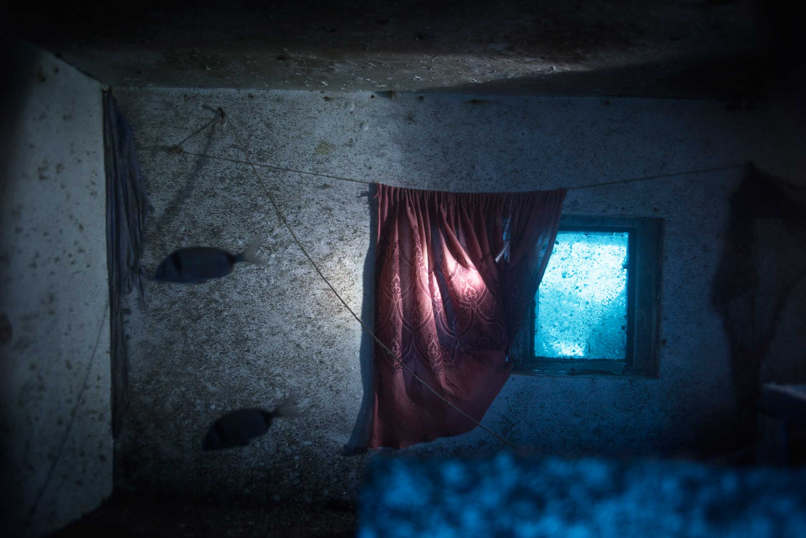The cabin inside the 66 ft long fishing boat that sunk off the coast of the Italian island of Lampedusa Oct. 3, 2013, killing 366 migrants, is seen on Sept. 22, 2014.