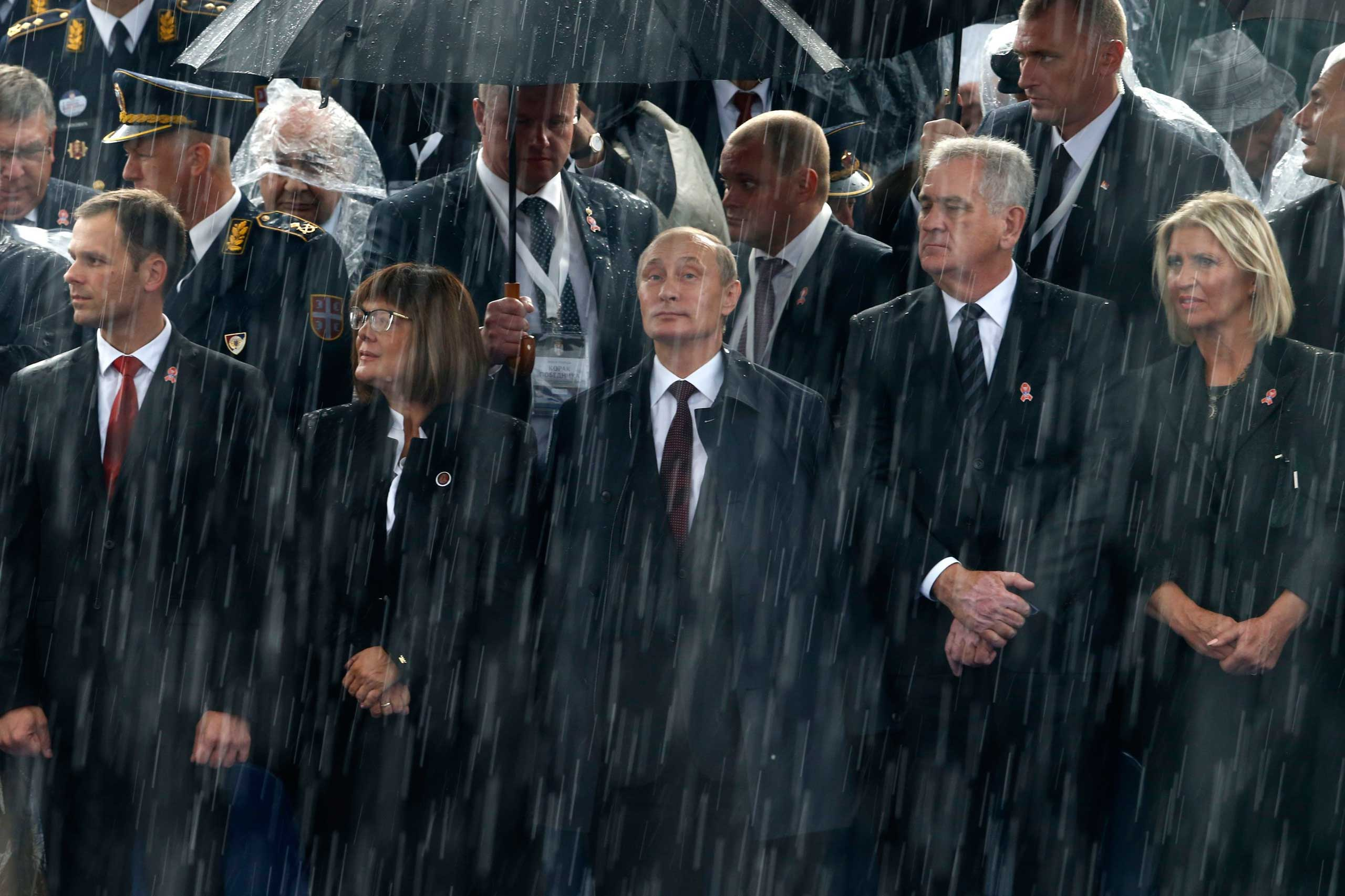 Russian President Vladimir Putin and Serbian President Tomislav Nikolic attend a military parade to mark 70 years since the city's liberation by the Red Army in Belgrade, Oct. 16, 2014.
