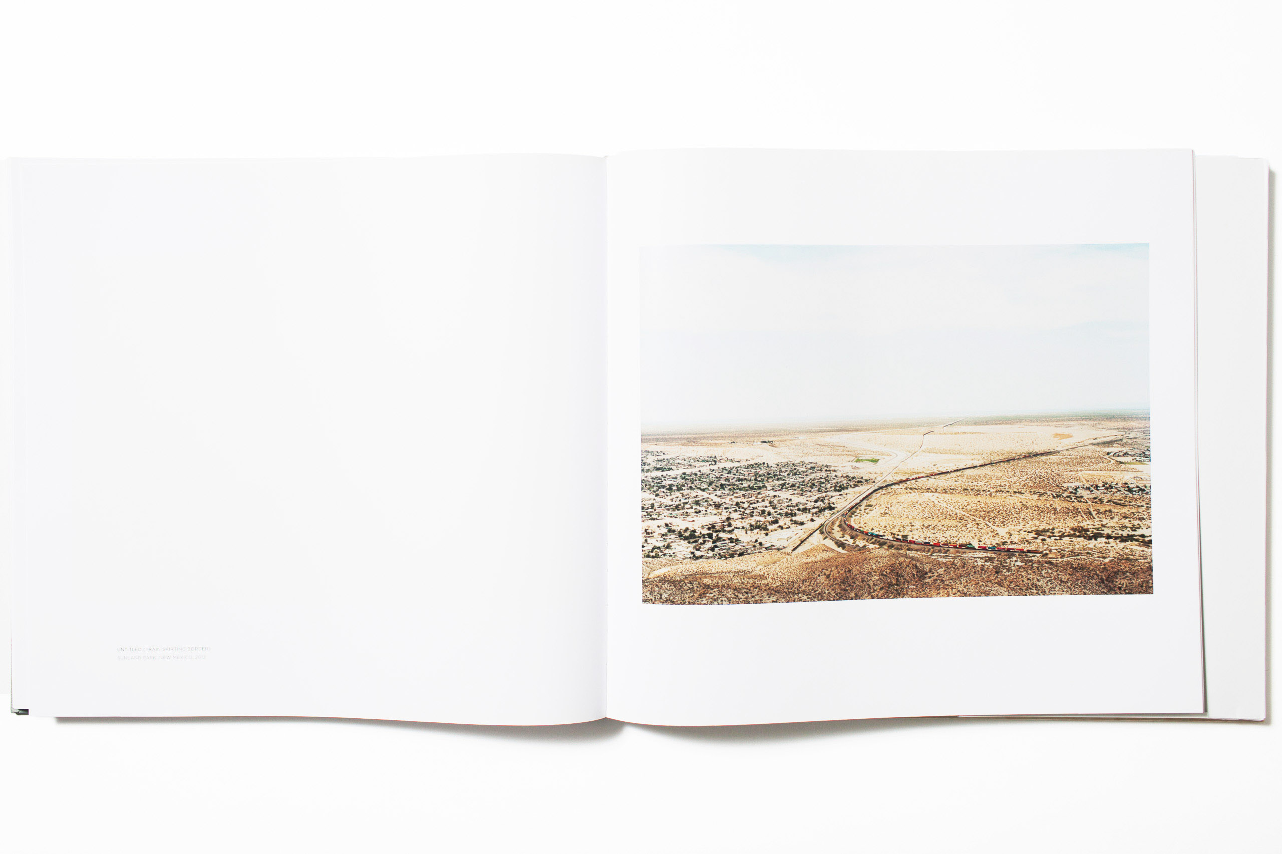 """""""Even when it comes to photo books I prefer small books— like note books and paperback novels, pocket sized—portable and unostentatious. This year there were several books that I responded to (Thomas Roma and Giancarlo T. Roma's <i>Waters of Our Time</i>,  Christoph Bangert's <i>War Porn</i> and Paul Graham <i>Does Yellow Run Forever?</i>) not only for their photographic content, but through their carefully considered design, and intimate size. But after much consideration, I chose a book on a larger scale (one I wouldn't mind if it were even bigger) that presents its content in an appropriately clean and modern manner.                                   Victoria Sambunaris' <i>Taxonomy of a Landscape</i> is a dedicated exploration of, and response to, the American Landscape. A fifteen year journey traversing the country, often for months at a time, that channels the intellectual and journalistic spirit of John McPhee's writings, the discovery of Robert Frank's Americans and the great American photographic traditions of the U.S. Geological Survey in the late 1800s, the Farm Security Administration (FSA) of the 1940s. and the New Topographics movement. The photographic study includes national parks, industrial parks and a 2,000 mile stretch along the U.S./ Mexican border—each documented from Sambunaris' unique and impeccable perspective. In the age of drones and digital photography, one woman traveling the country alone by car with a 5x7 wooden film camera, has delivered a book for the ages.""""                                                                      -Phil Bicker, Senior Photo Editor TIME."""