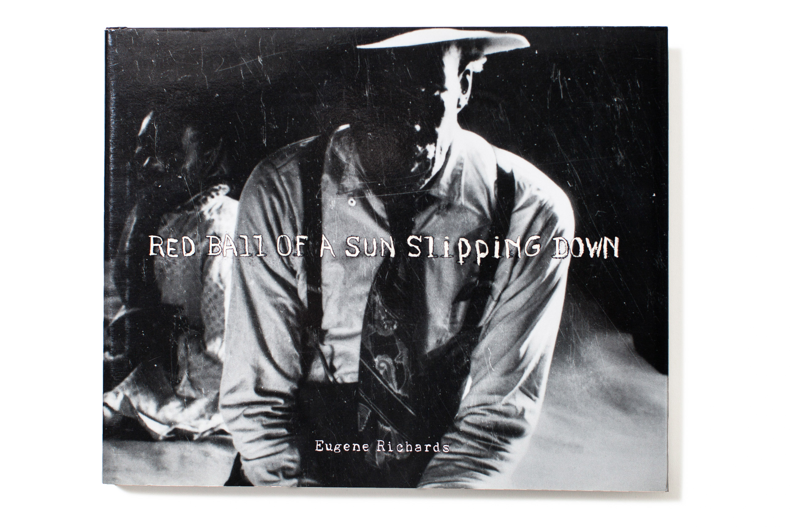"""<a href=""""http://www.amazon.com/Eugene-Richards-Ball-Slipping-Down/dp/0991218906""""><i><b>                                   Red Ball of the Sun Slipping Down                                   </i></b></a> by                                   Eugene Richards,                                    published by                                   Many Voices Press,                                   selected by Olivier Laurent, Editor, <i>TIME</i> LightBox."""