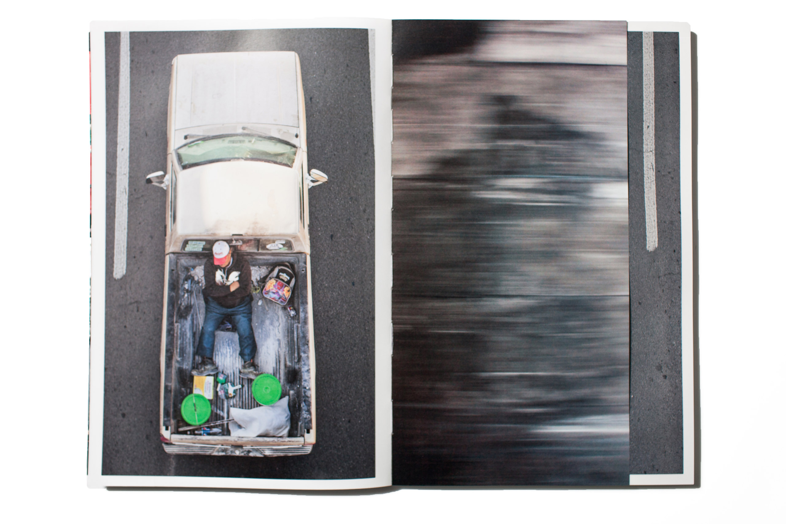 Although we have seen this work before, what a pleasure to see how this self published project, so cleverly combines the photos of the passing open plan trucks with their passengers laid out flat, but also the skies and scenes that can be viewed from the truck itself.                                                               -Martin Parr, Photographer at Magnum Photos