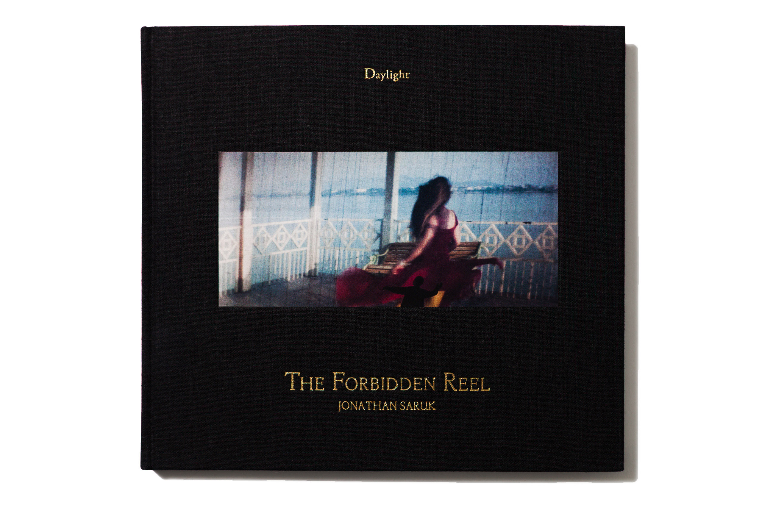 "<a href=""https://daylightbooks.org/store/jonathan-saruk-forbidden-reel""><i><b>The Forbidden Reel</a></i></b> by Jonathan Saruk, published by Daylight Books, selected by Marisa Schwartz, Associate Photo Editor, <i>TIME.com</i>."