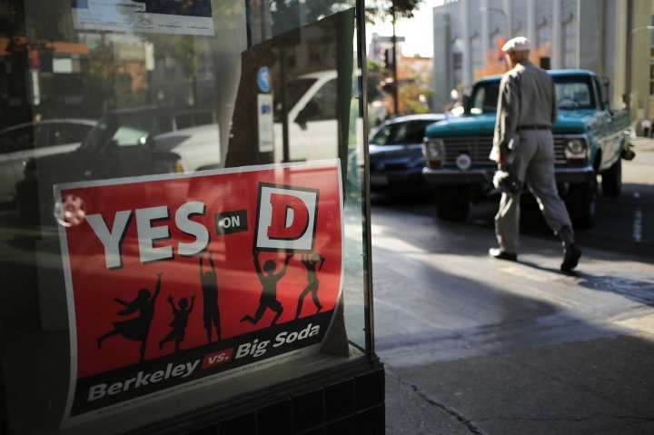 "A sign for the ""Yes on D"" campaign in the window of the Measure D election headquarters in Berkeley, Calif., Nov. 3, 2014."