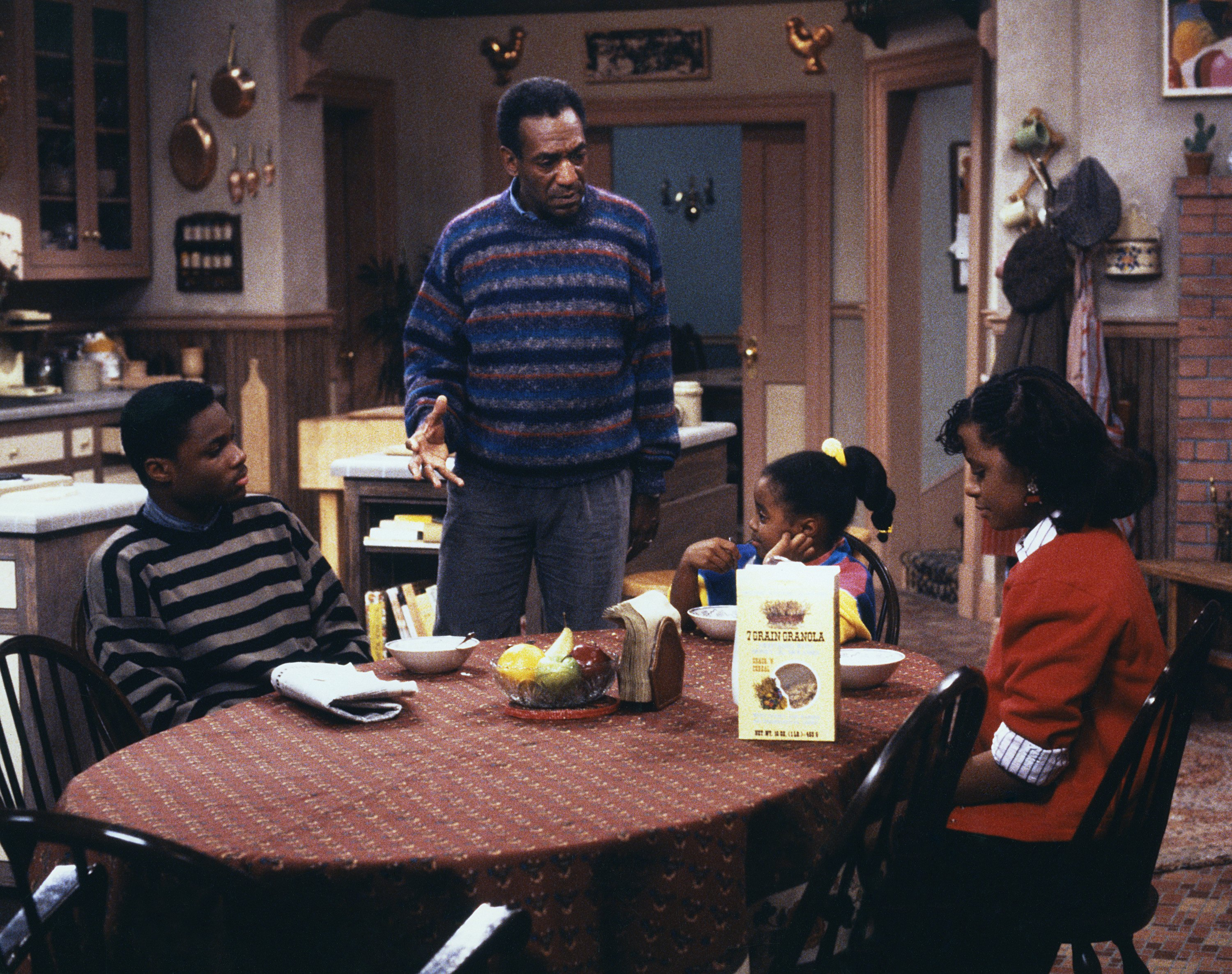 (Left to Right) Malcolm-Jamal Warner as Theodore 'Theo' Huxtable, Bill Cosby as Dr. Heathcliff 'Cliff' Huxtable, Keshia Knight Pulliam as Rudy Huxtable, Tempestt Bledsoe as Vanessa Huxtable on The Cosby Show.