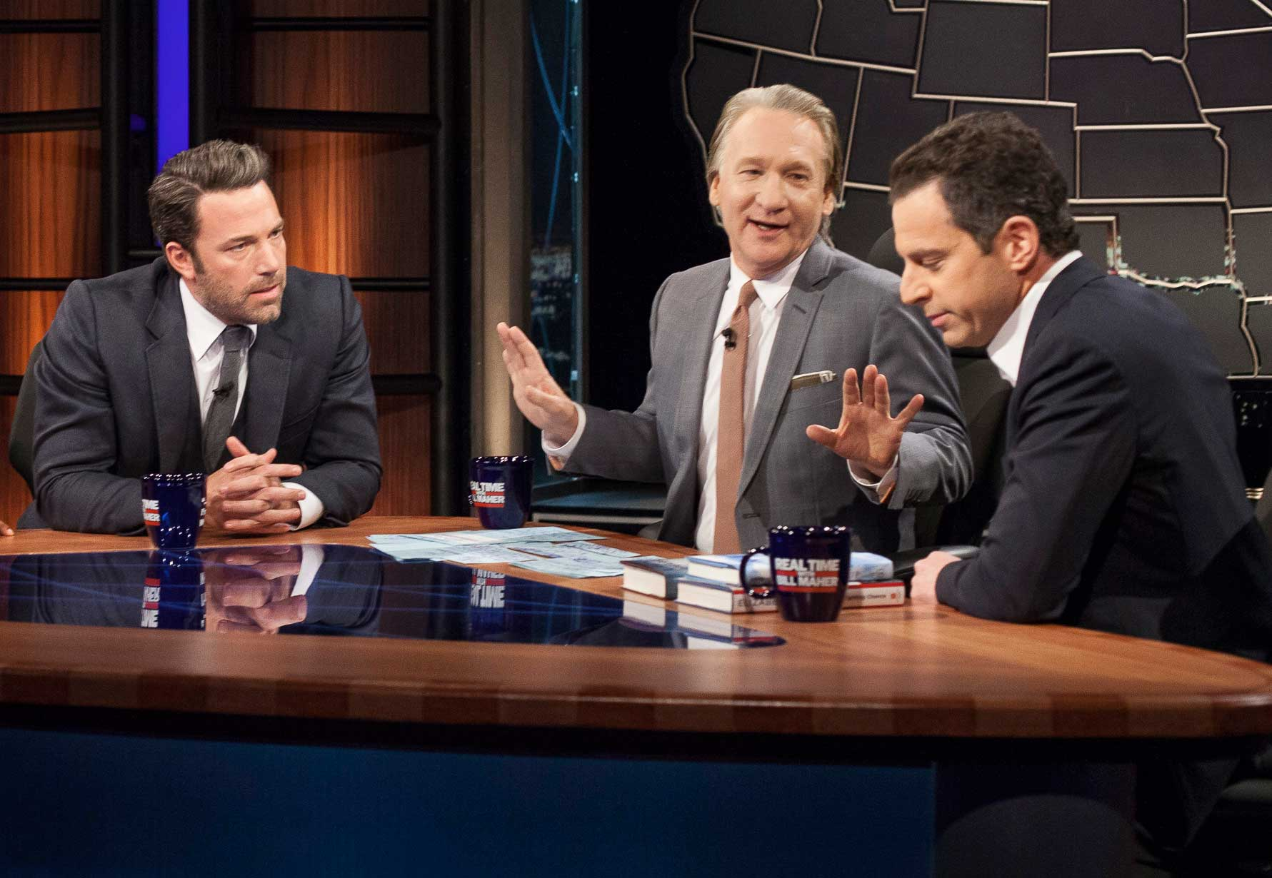 Host Bill Maher, center, talks with actor Ben Affleck, left, and Sam Harris, author of  Waking Up: A Guide to Spirituality Without Religion , during  Real Time With Bill Maher,  in Los Angeles on Oct. 3, 2014.
