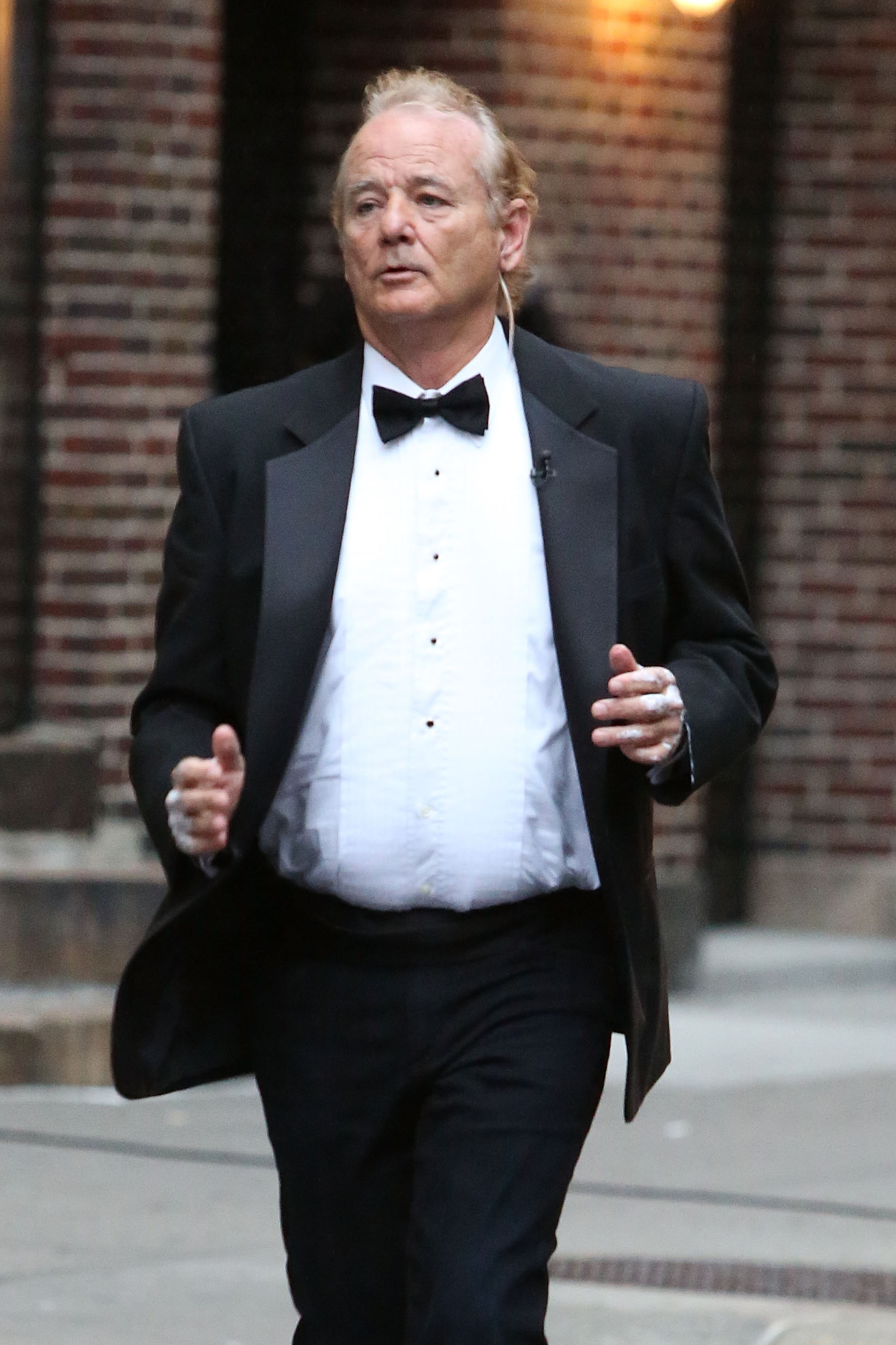 Actor Bill Murray goes jogging in black tie outside of  Late Show with David Letterman  on October 15, 2014 in New York City.
