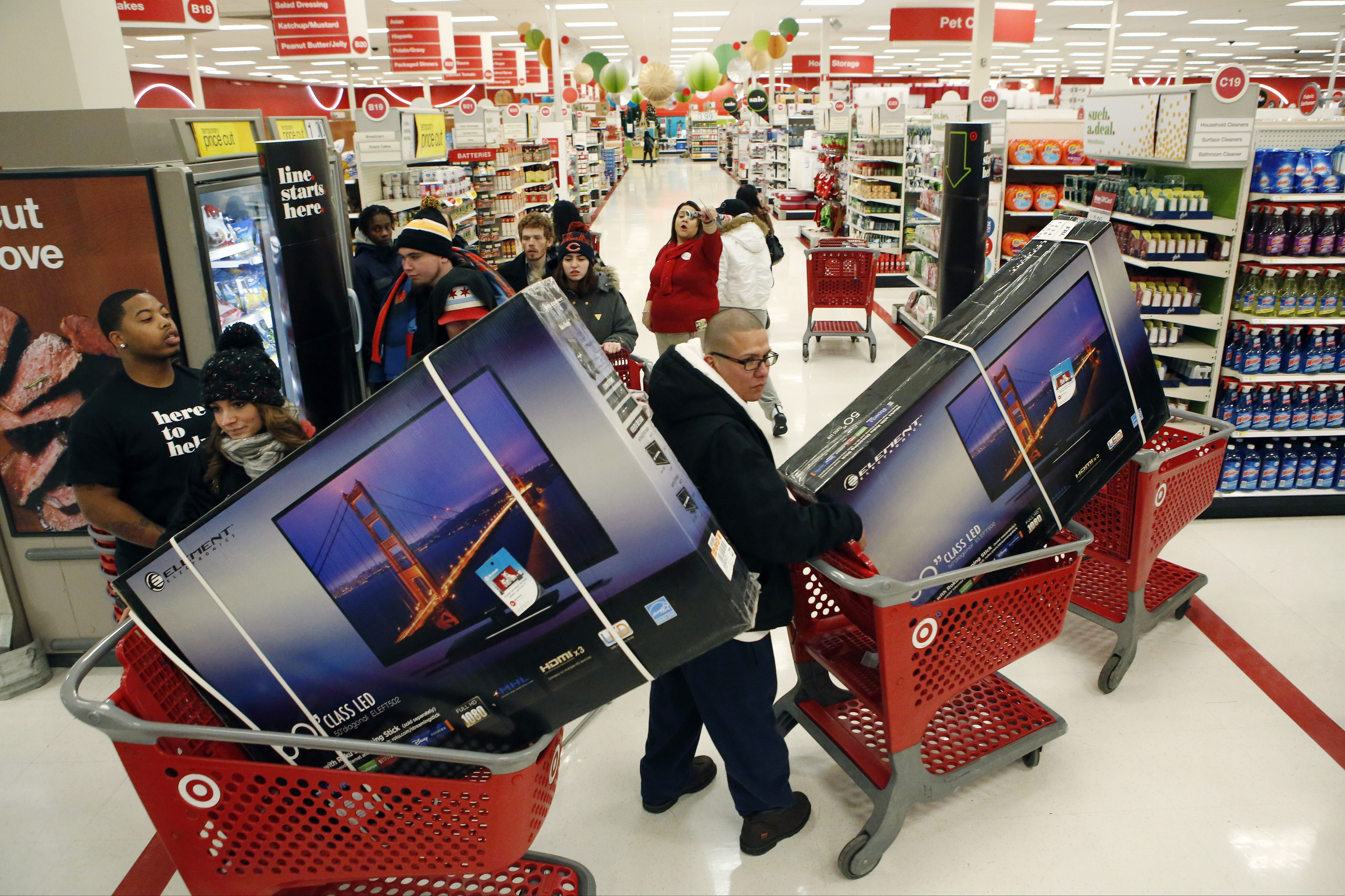 Customers pick up shopping carts containing Element Electronics 50-inch light-emitting diode (LED) high definition televisions at a Target Corp. store opening ahead of Black Friday in Chicago, Illinois, U.S., on Thursday, Nov. 28, 2013.