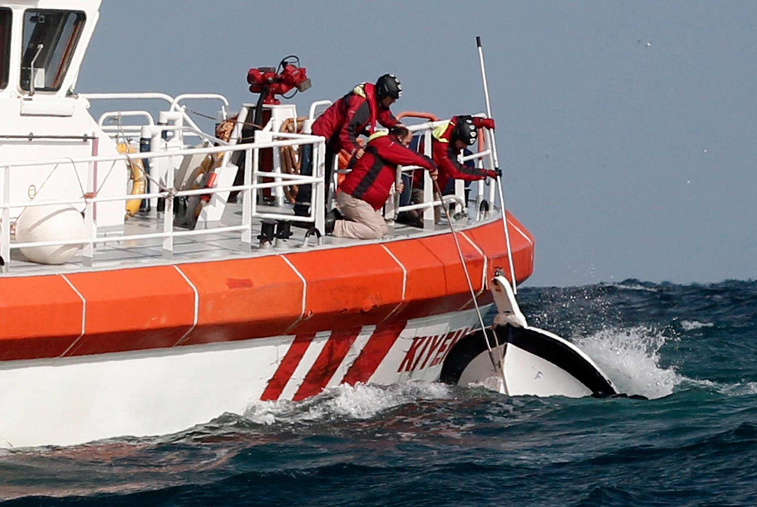 Rescuers retrieve a boat that sank, killing 24 migrants, off the Black Sea village of Garipce near Istanbul on Nov. 3, 2014.
