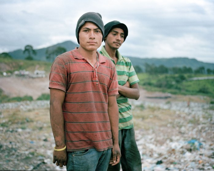 Angel and Gerson pose for a portrait in the municipal dump where they work in Tegucigalpa  (Dominic Bracco II / Prime for Pulitzer Center on Crisis Reporting)