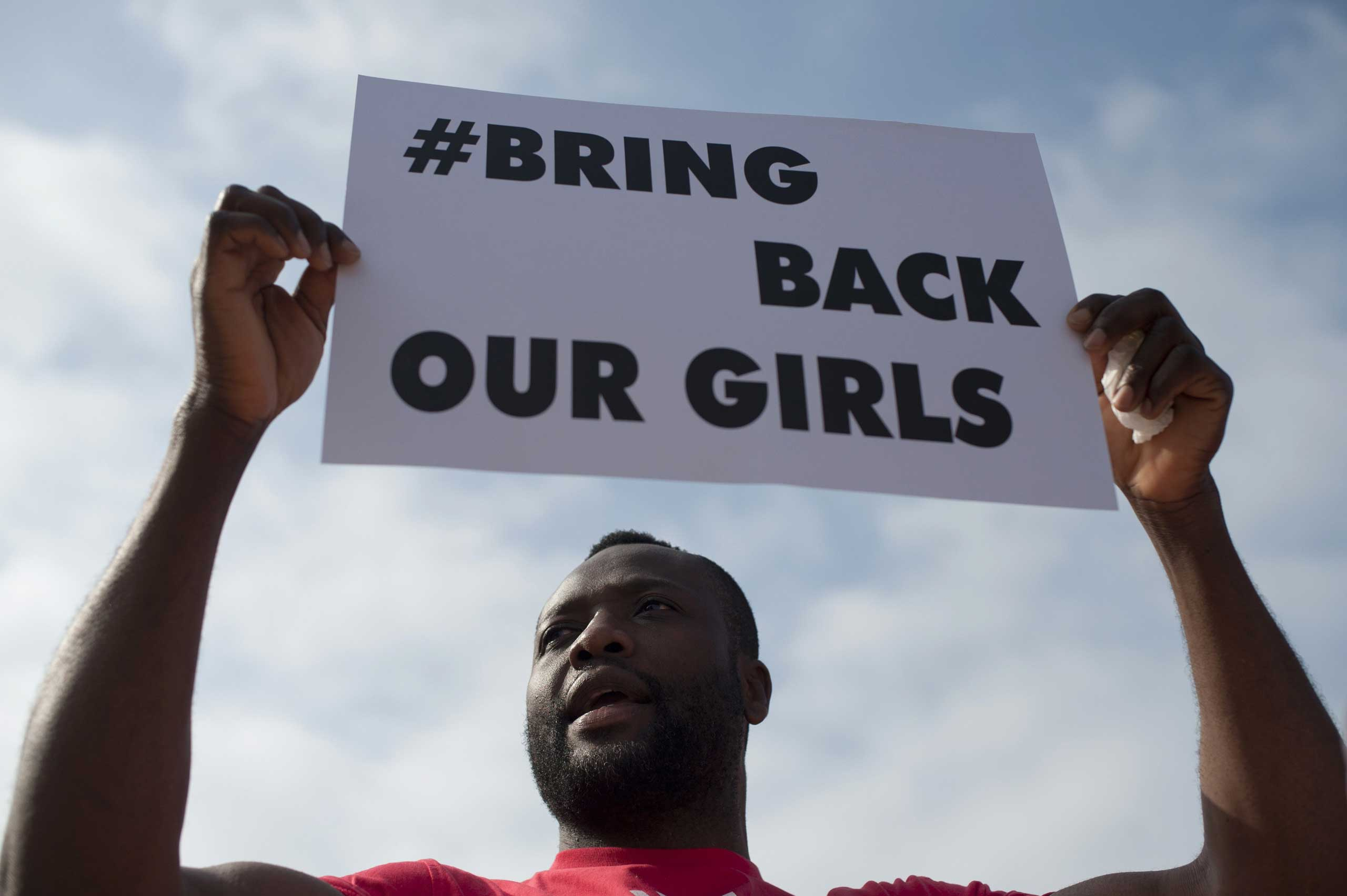 A man holds a placard reading  Bring Back Our Girls  to denounce the kidnapping of more than 200 Nigerian schoolgirls by Islamic militants on May 13 , 2014 in Malaga.