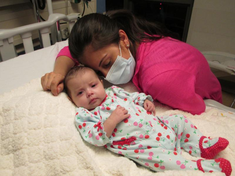 Alysia Padilla-Vacarro and daughter Evangelina on the day of her gene therapy treatment. Evangelina, now two years old, has had her immune system restored and lives a healthy and normal life.