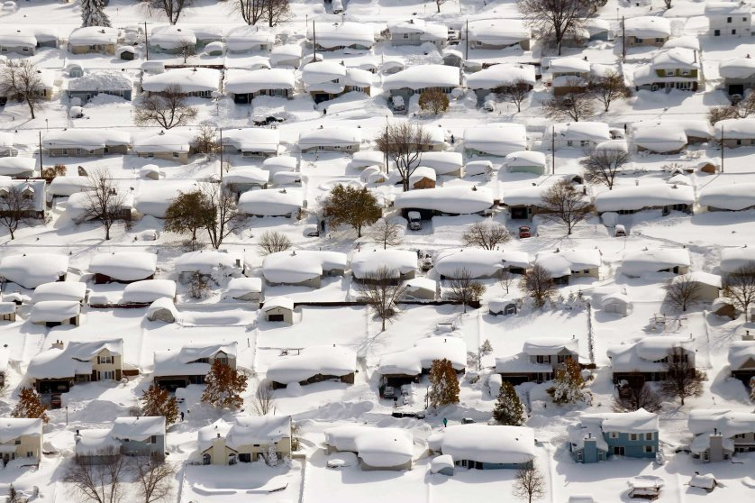 Homes are covered in snow in West Seneca, N.Y. on Nov. 19, 2014. The Buffalo area found itself buried under as much as 5½ feet of snow with another lake-effect storm expected to bring 2 to 3 more feet.