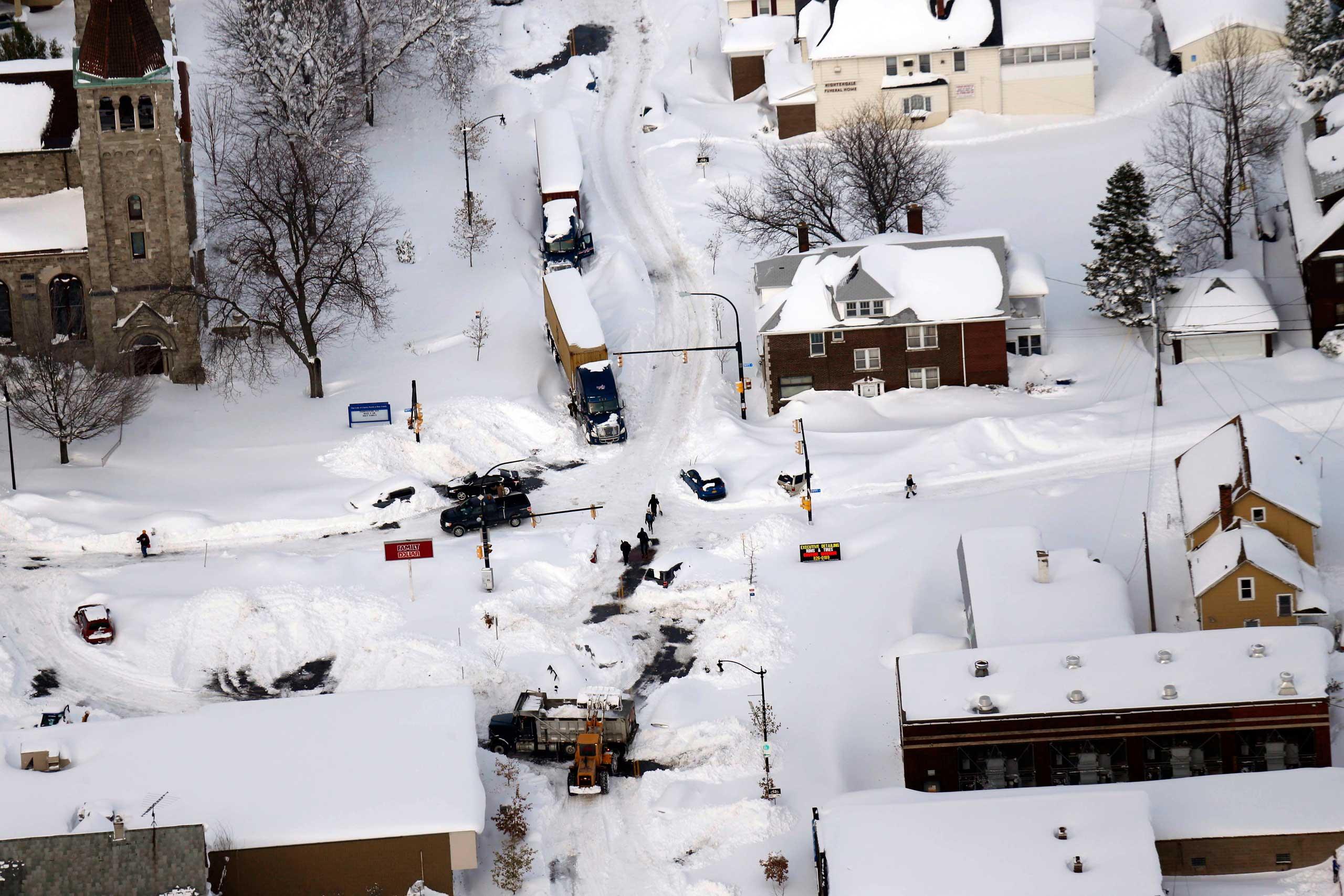 Cars make their way through South Buffalo, N.Y. on Nov. 19, 2014.