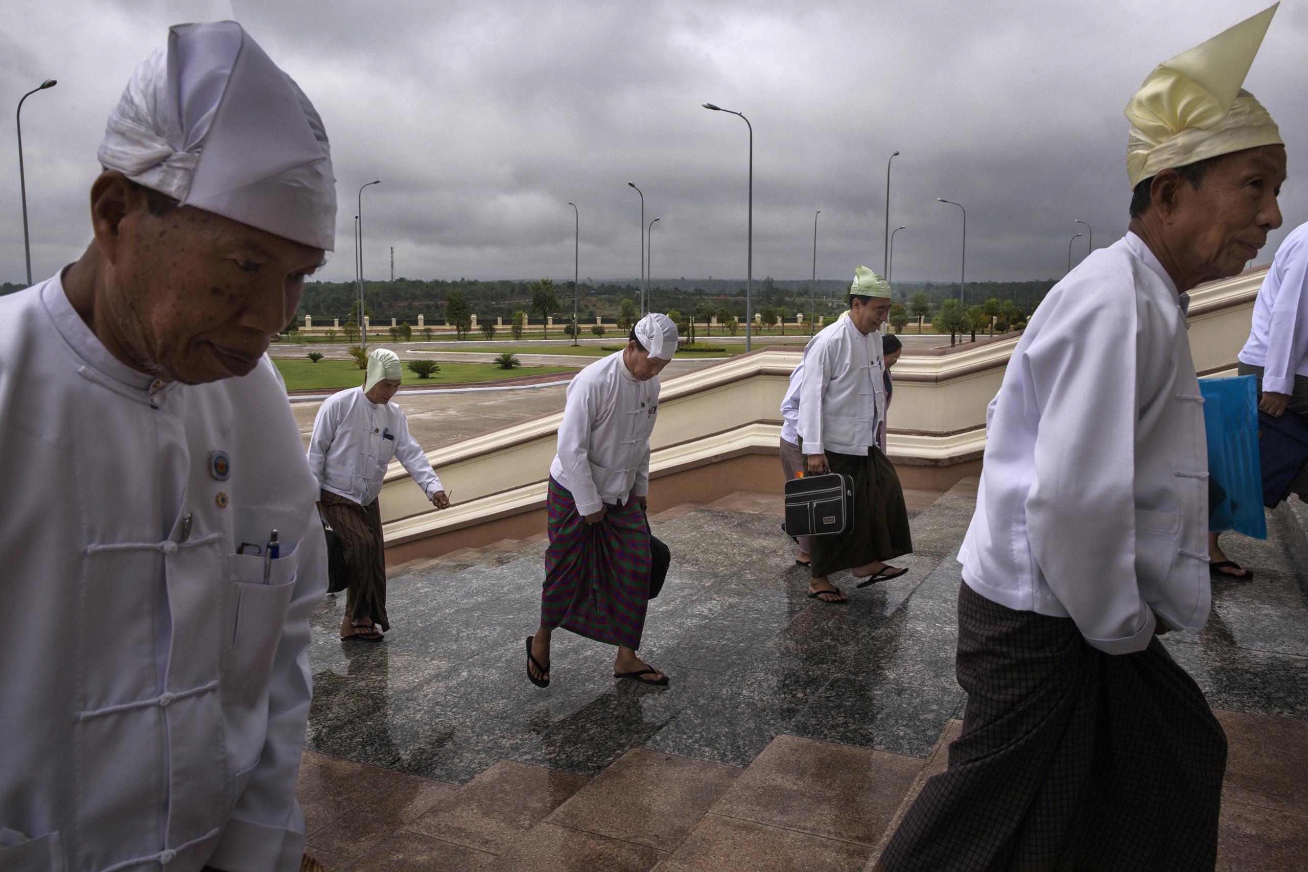 MPs arrive at the Parliament in Naypyidaw, Burma,  June 20, 2014.