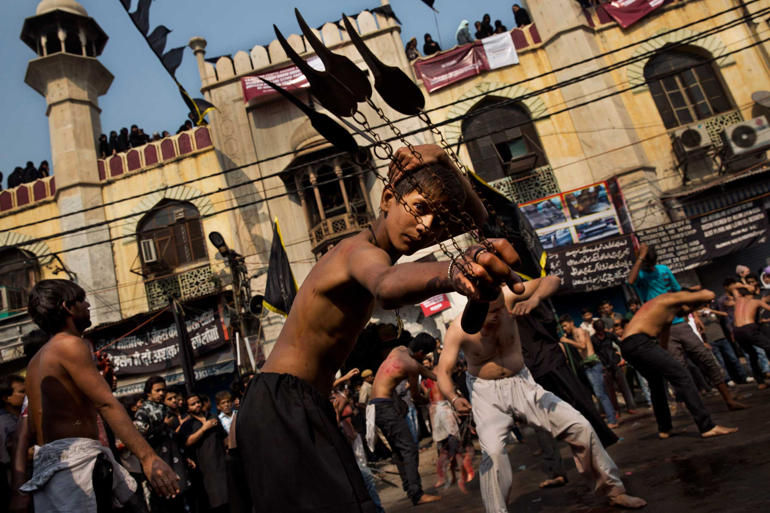 Nov. 4, 2014. A young Indian Shiite Muslim flagellates himself during a procession to mark Ashoura in New Delhi. Shiites mark Ashura, the tenth day of the month of Muharram, to commemorate the Battle of Karbala when Imam Hussein, a grandson of Prophet Muhammad, was killed.