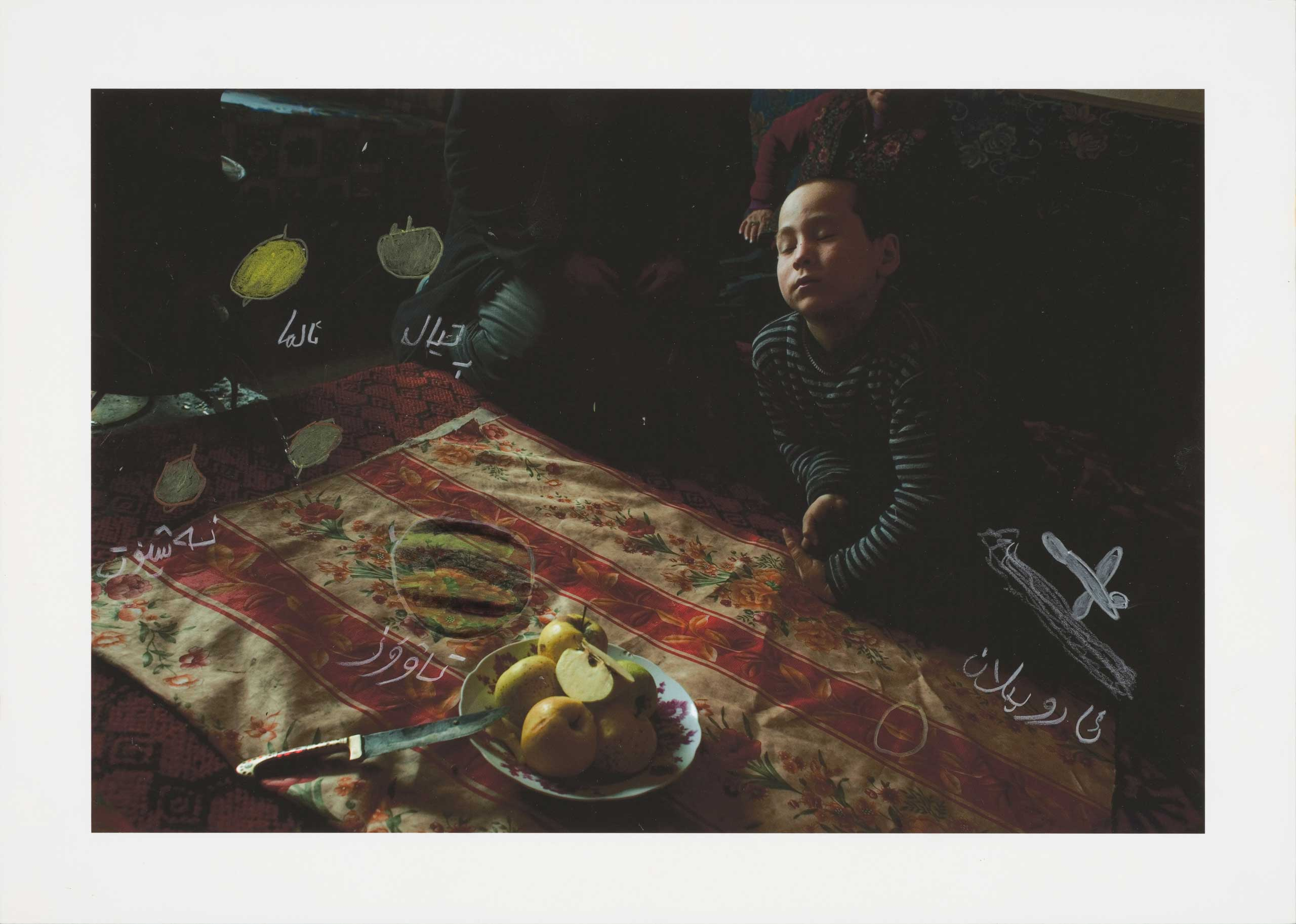 In 2011, I visited a family I had met a few years earlier in a village on the southern edge of the desert. I took pictures as we gathered around the table for lunch. When I returned with the print later that year, we again sat down in front of plates of fruit, this time to draw. 2011
