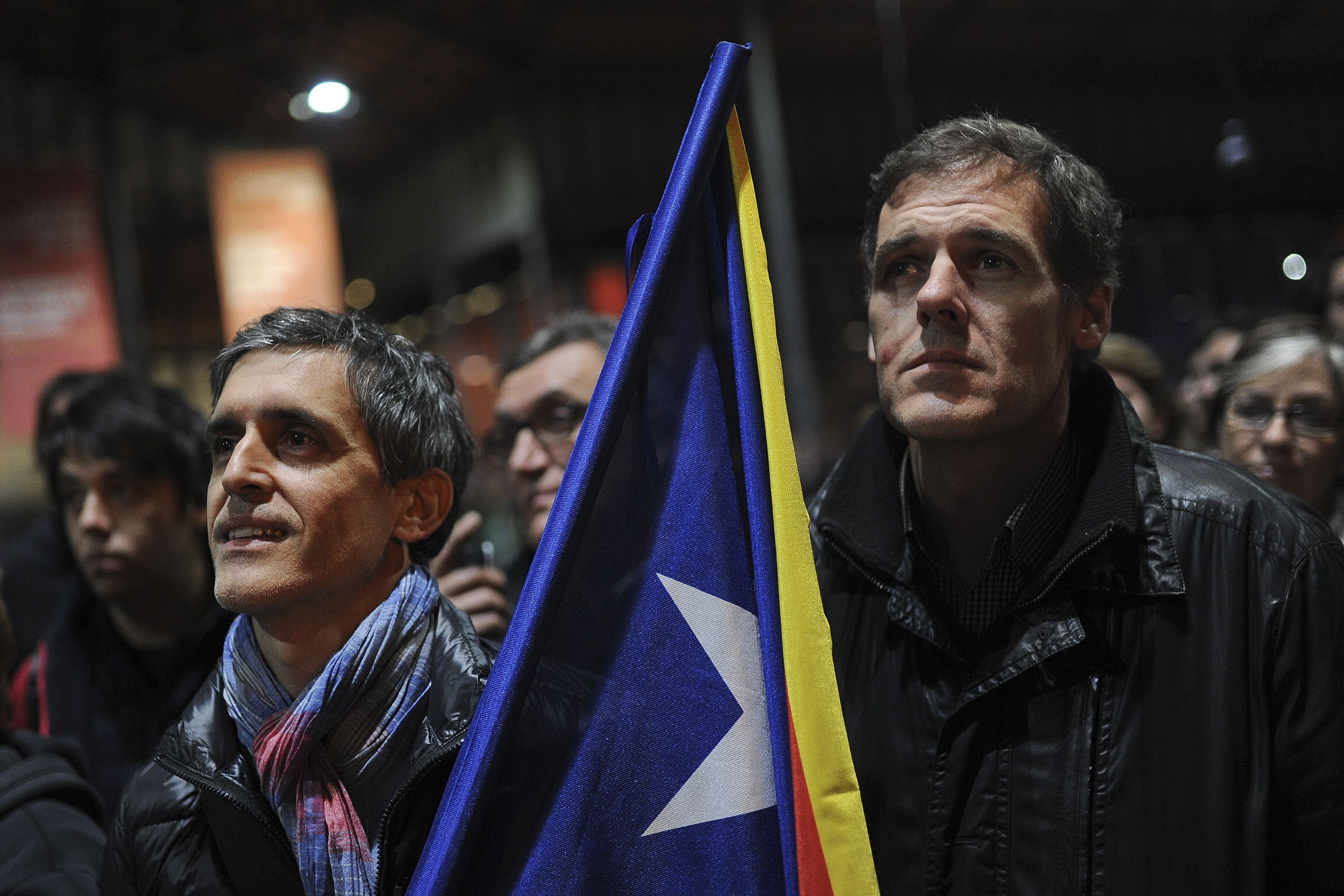 Pro-independence activists attend a meeting after a symbolic vote on independence for Catalonia from Spain at a polling station in Barcelona on Nov. 9, 2014.