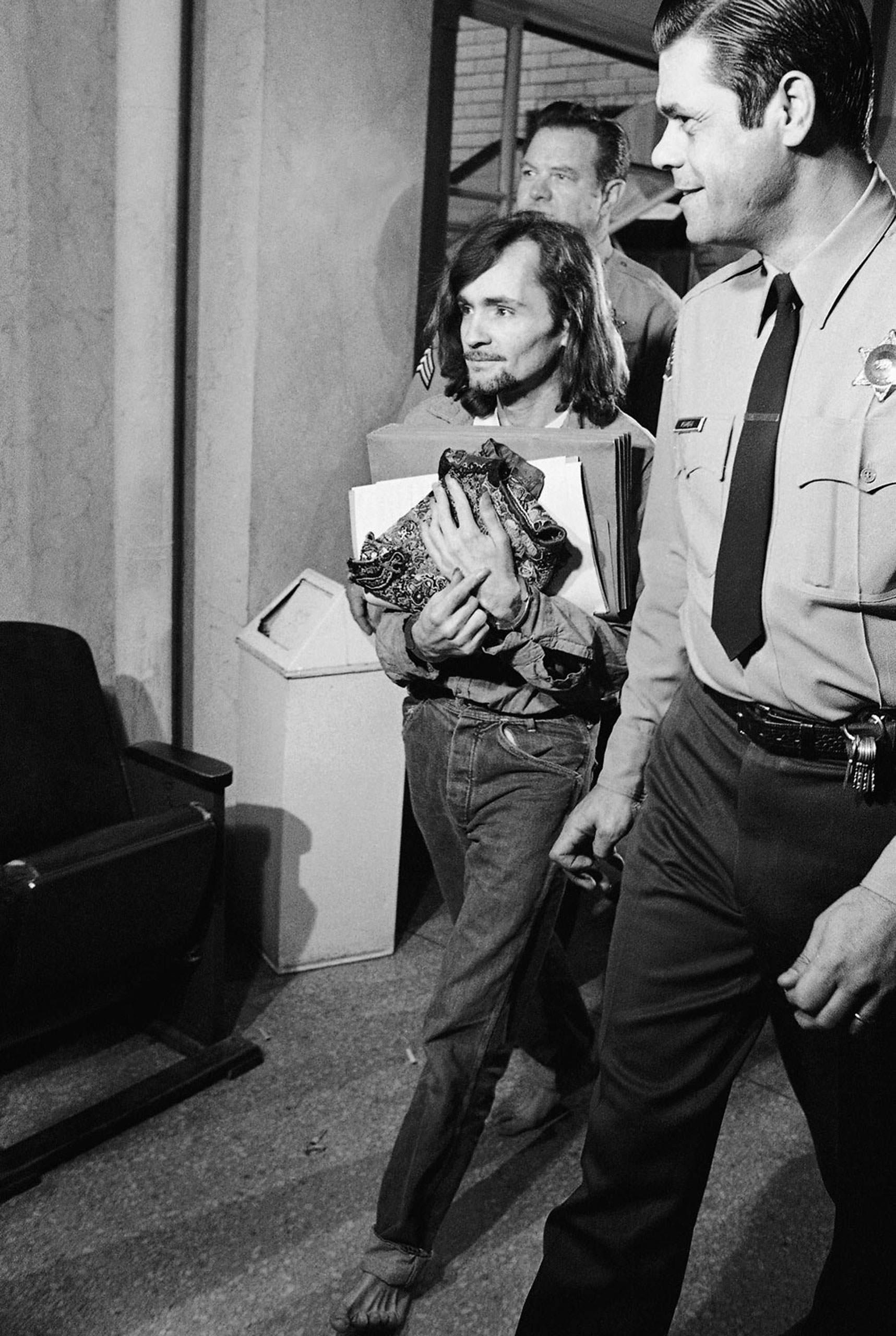 Charles Manson, accused of seven killings including that of actress Sharon Tate, leaves a Los Angeles courtroom, on Feb. 16, 1970 where he was denied a change of venue. The court ruled he can receive a fair trial in Los Angeles despite massive pretrial publicity.