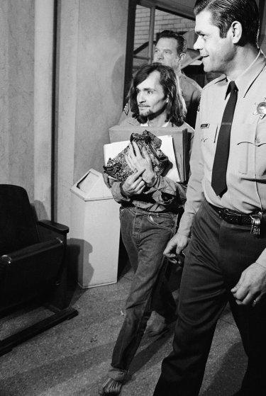 Charles Manson, accused of seven killings including that of actress Sharon Tate, leaves a Los Angeles courtroom, on Feb. 16, 1970 where he was denied a change of venue.